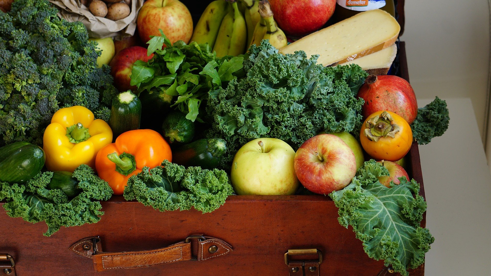 Healthy fruits and vegetables inside a suitcase