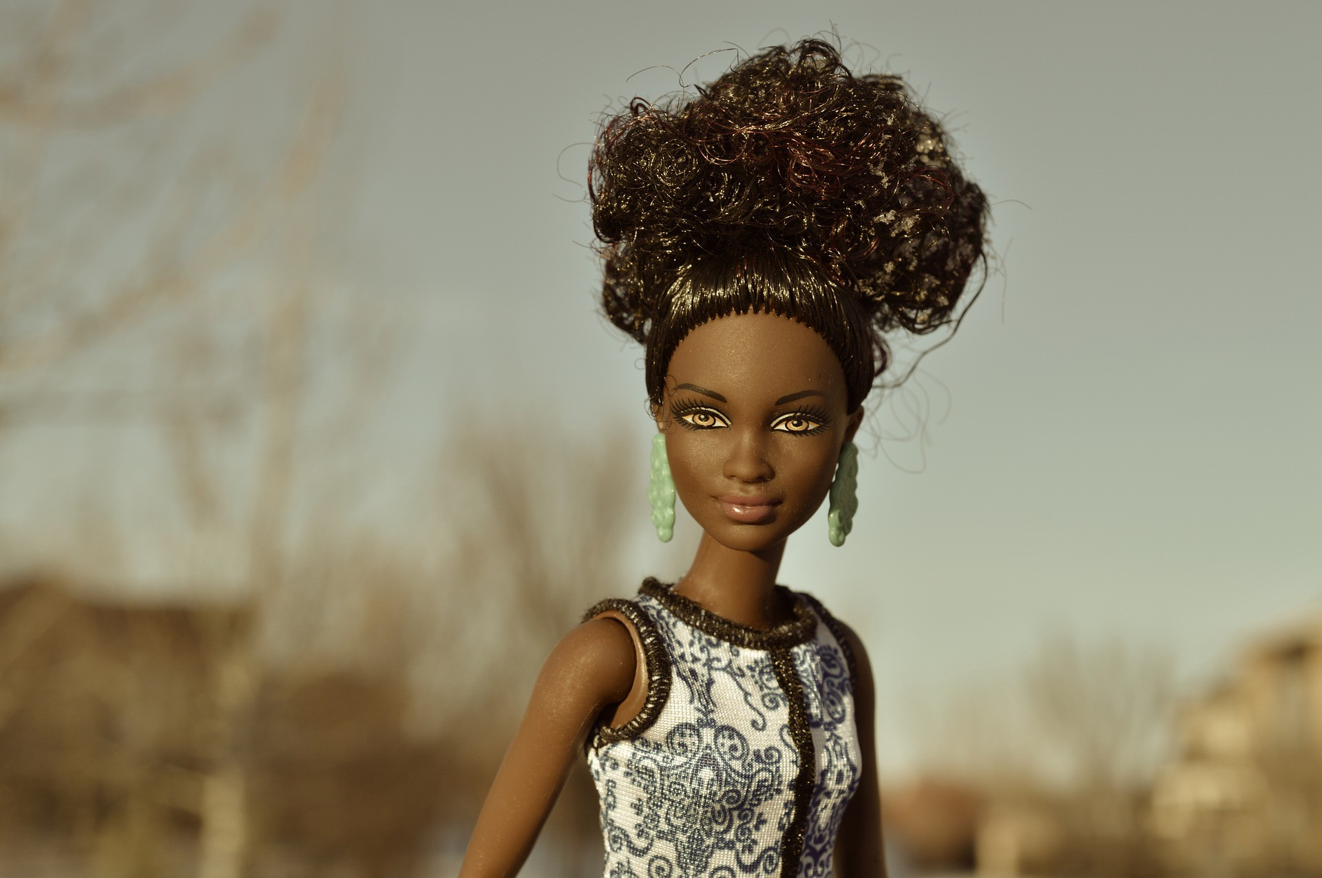 Mattel Toy Company Innovative Thinking: A Black Barbie Doll is looking at the camera. Created by Ruth Handler.