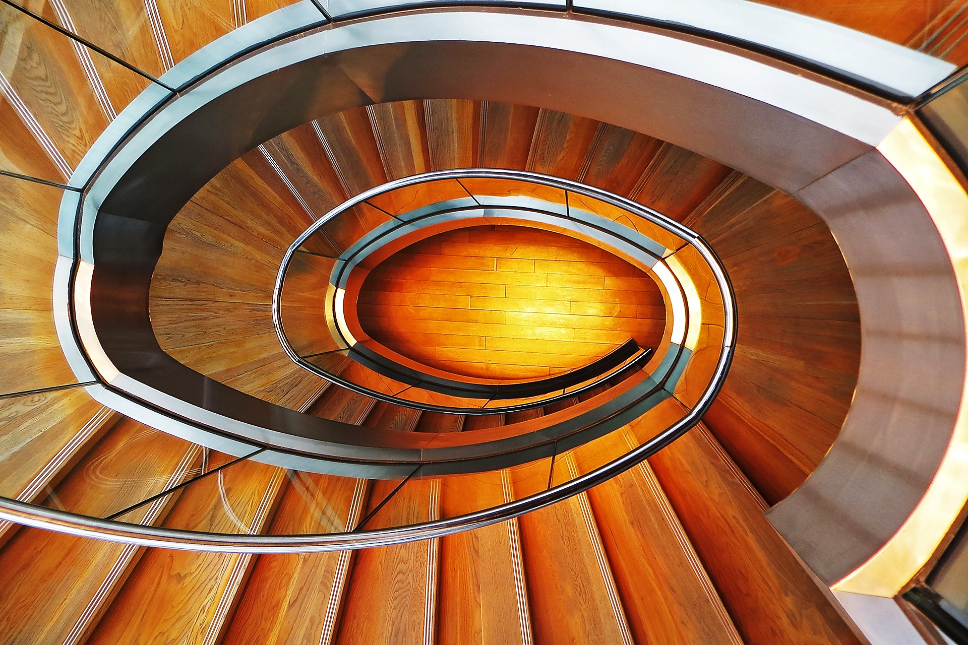 Downward view of a large spiral staircase
