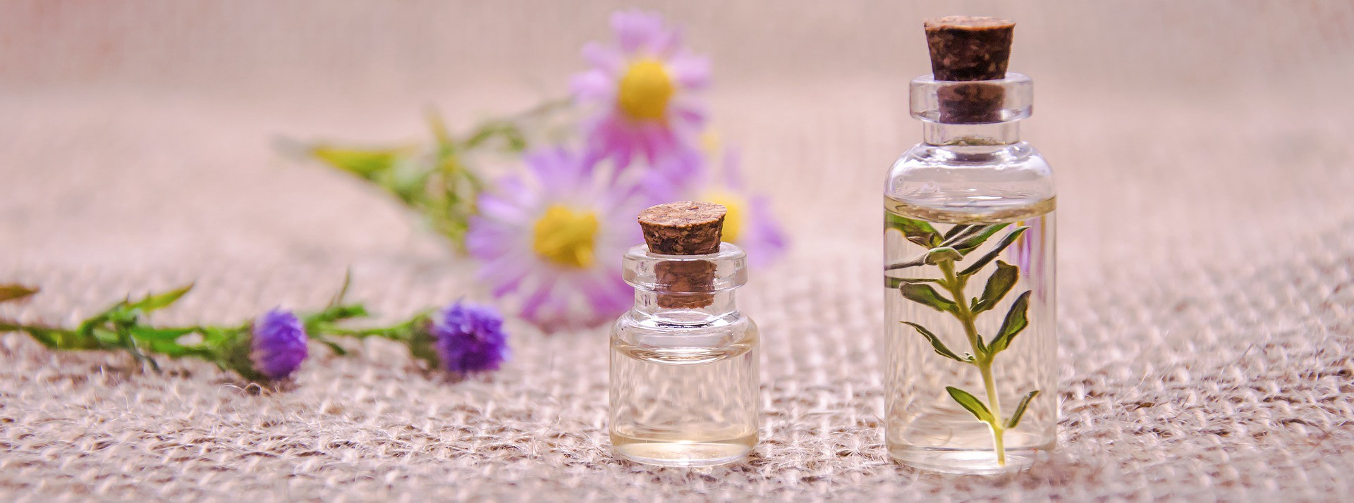 essential oils and violet flowers