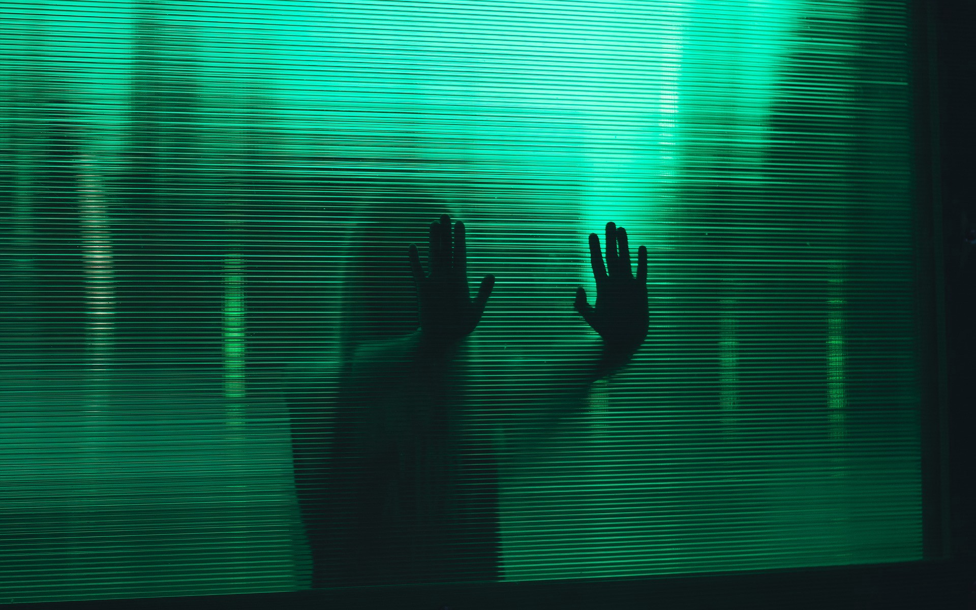 Picture of person touching glass