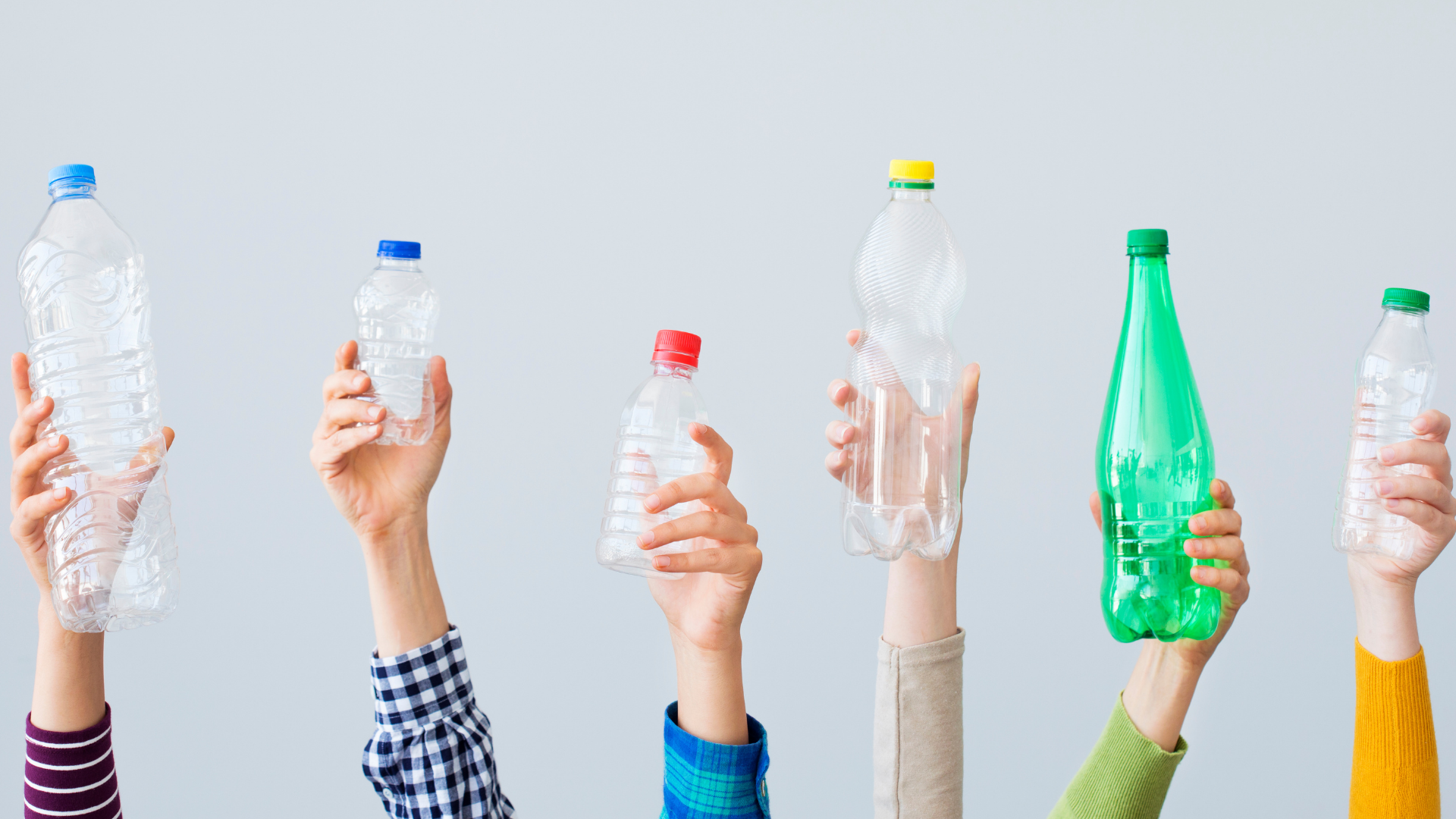 6 individuals holding up 6 different types of plastic bottles in different colours wearing different coloured clothing