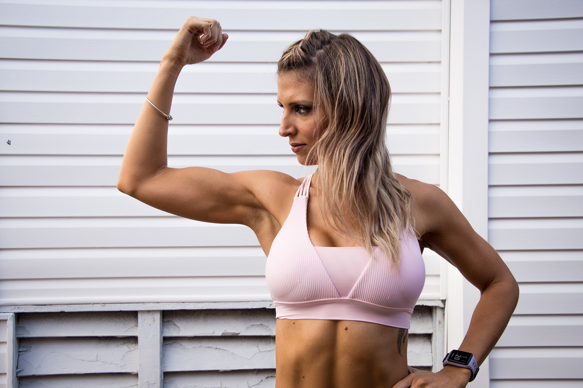 Athletic woman flexing her bicep.