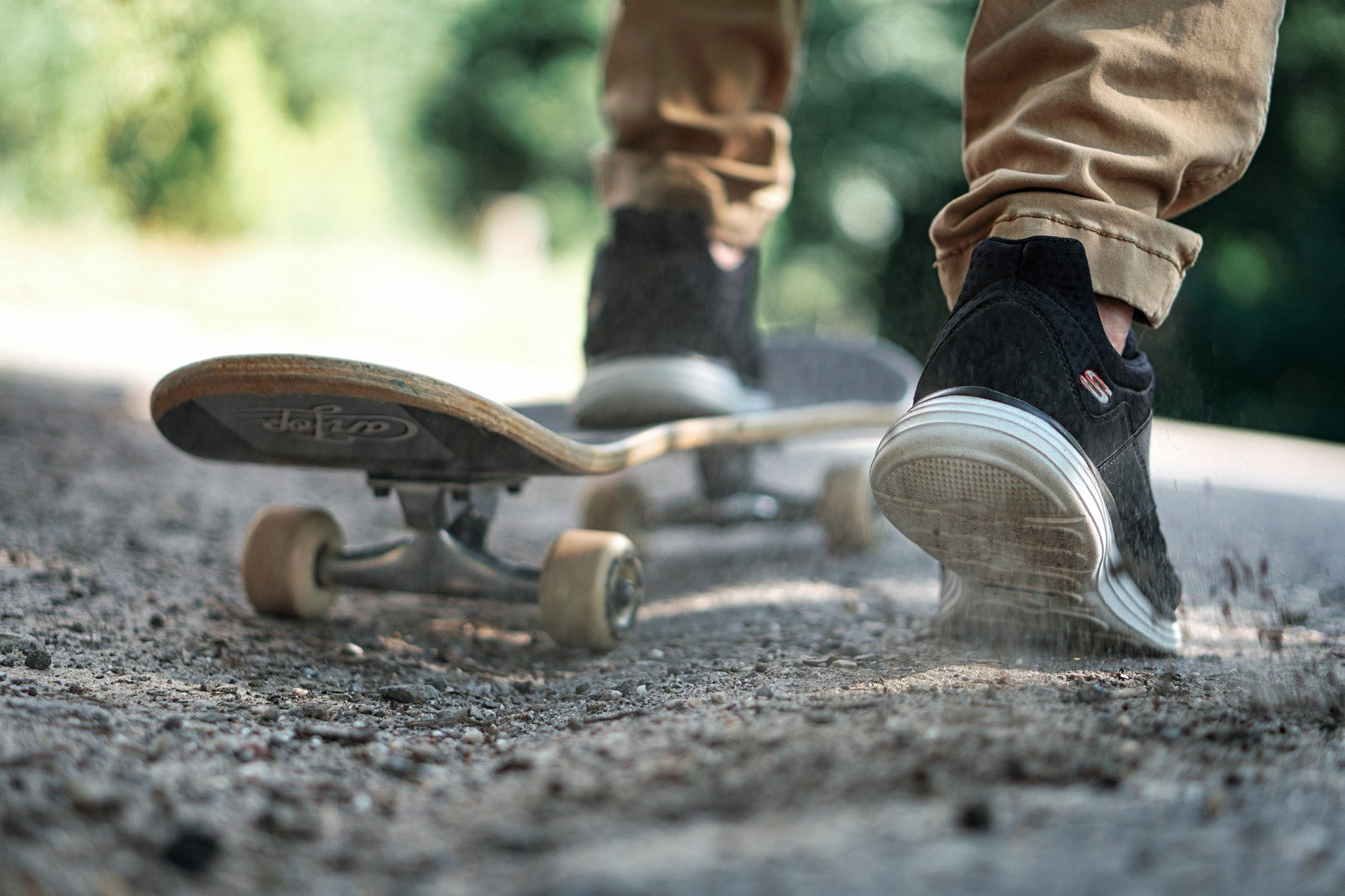 Close up of someone standing on a skateboard