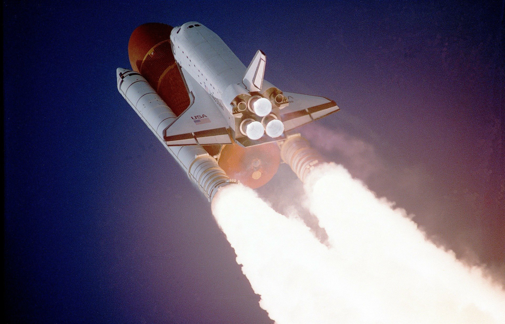 space shuttle flying