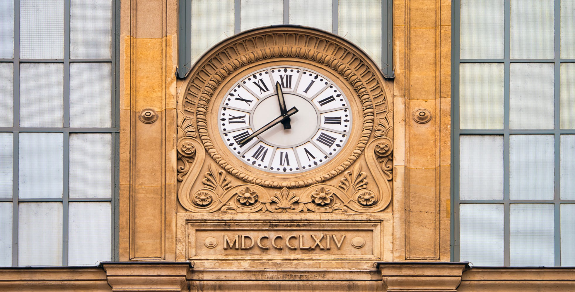 Roman numerals on a clock and showing year 1864