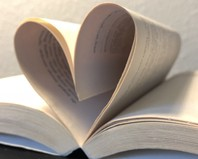 Book with the pages open in a heart shape