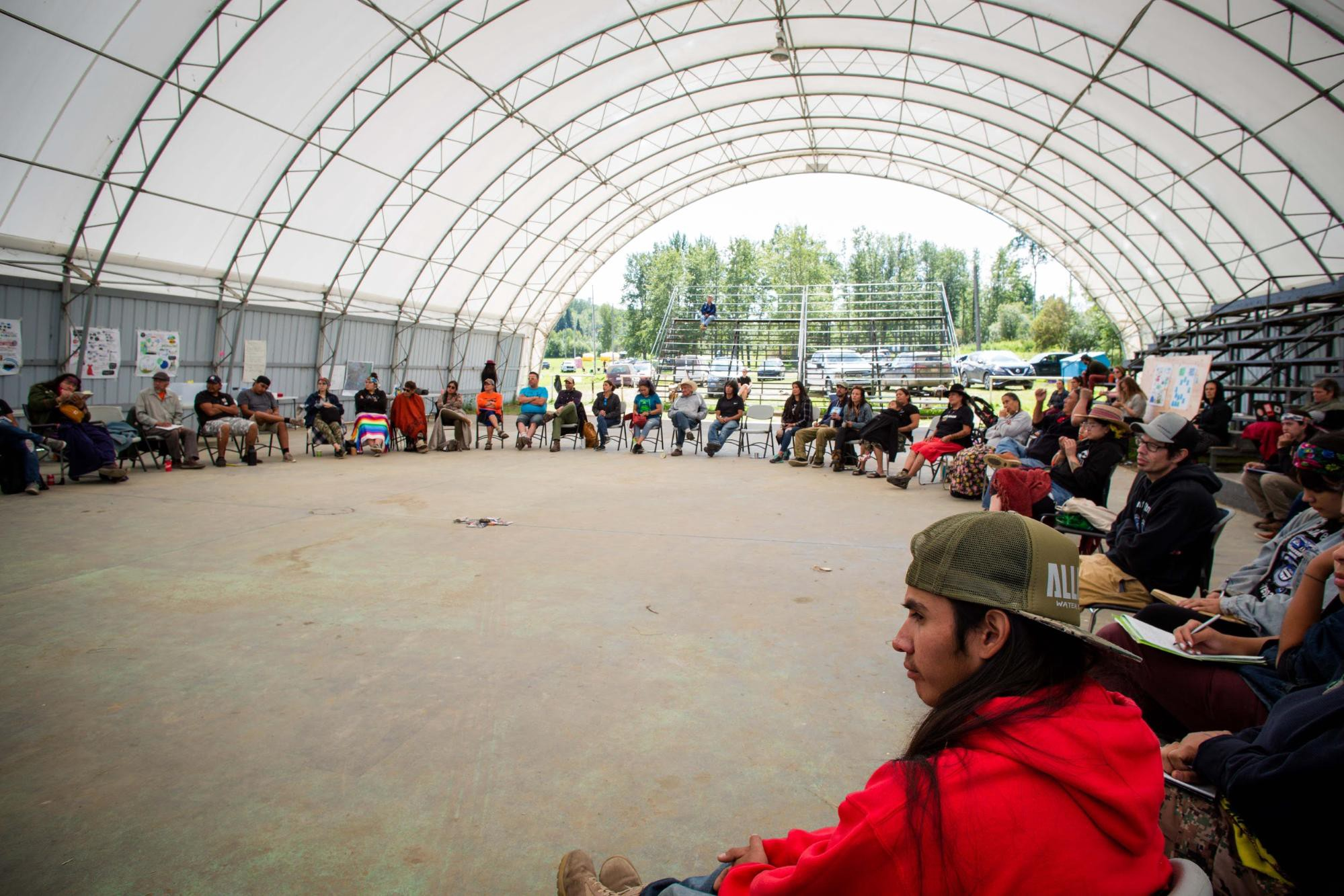 """Indigenous and First Nations participants start off the """"Bringing Our Voices Together"""" summit session in a circle."""