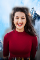 woman smiling with background replaced by mountains