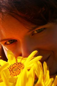 Woman with flower to illustrate an article about  autism