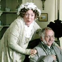 Mrs. Bennet standing behind Mr. Bennet making a very excited face from the BBC Pride and Prejudice mini-series.