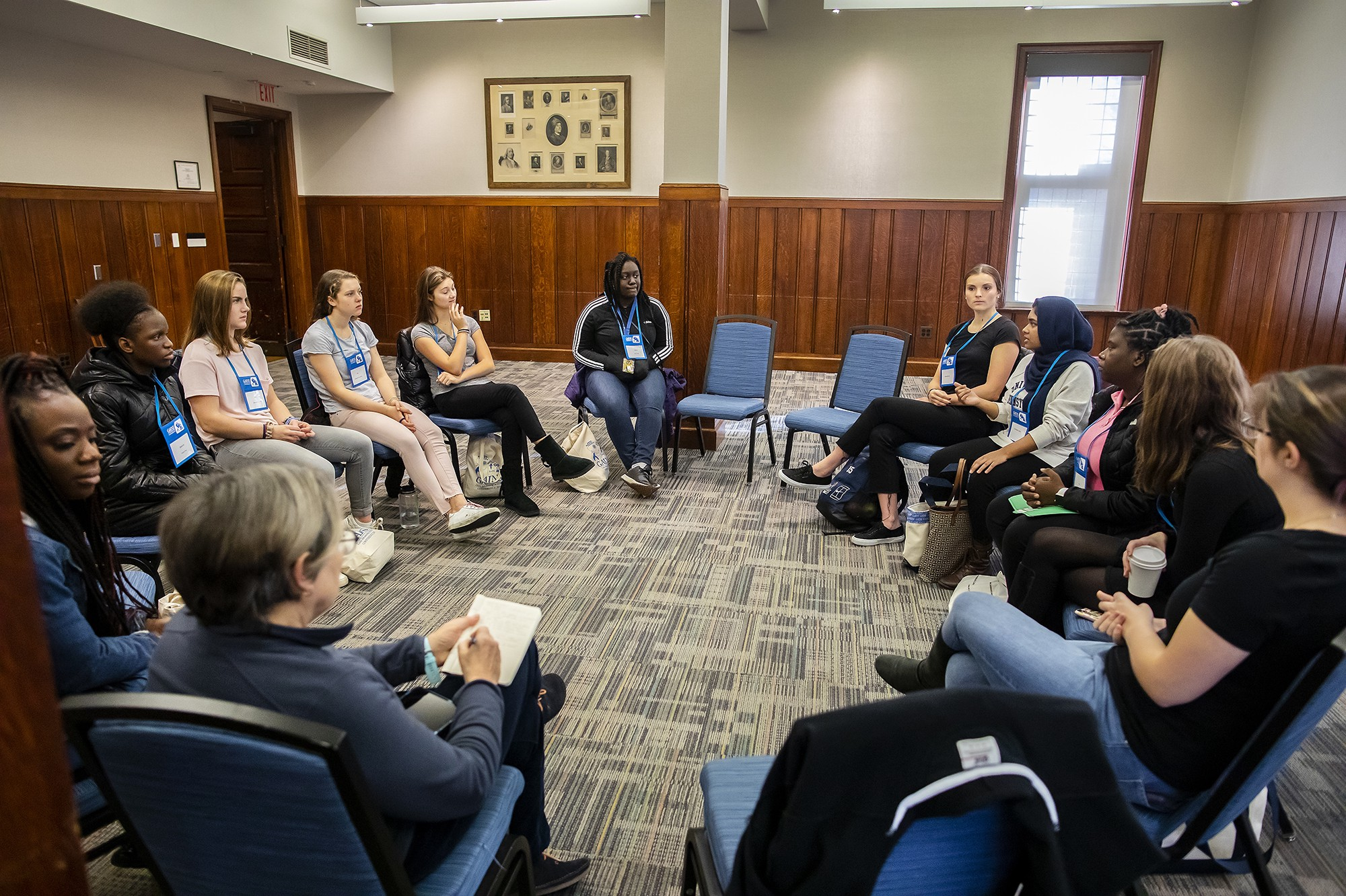 Women attending the GAINS conference sit in a discussion circle.