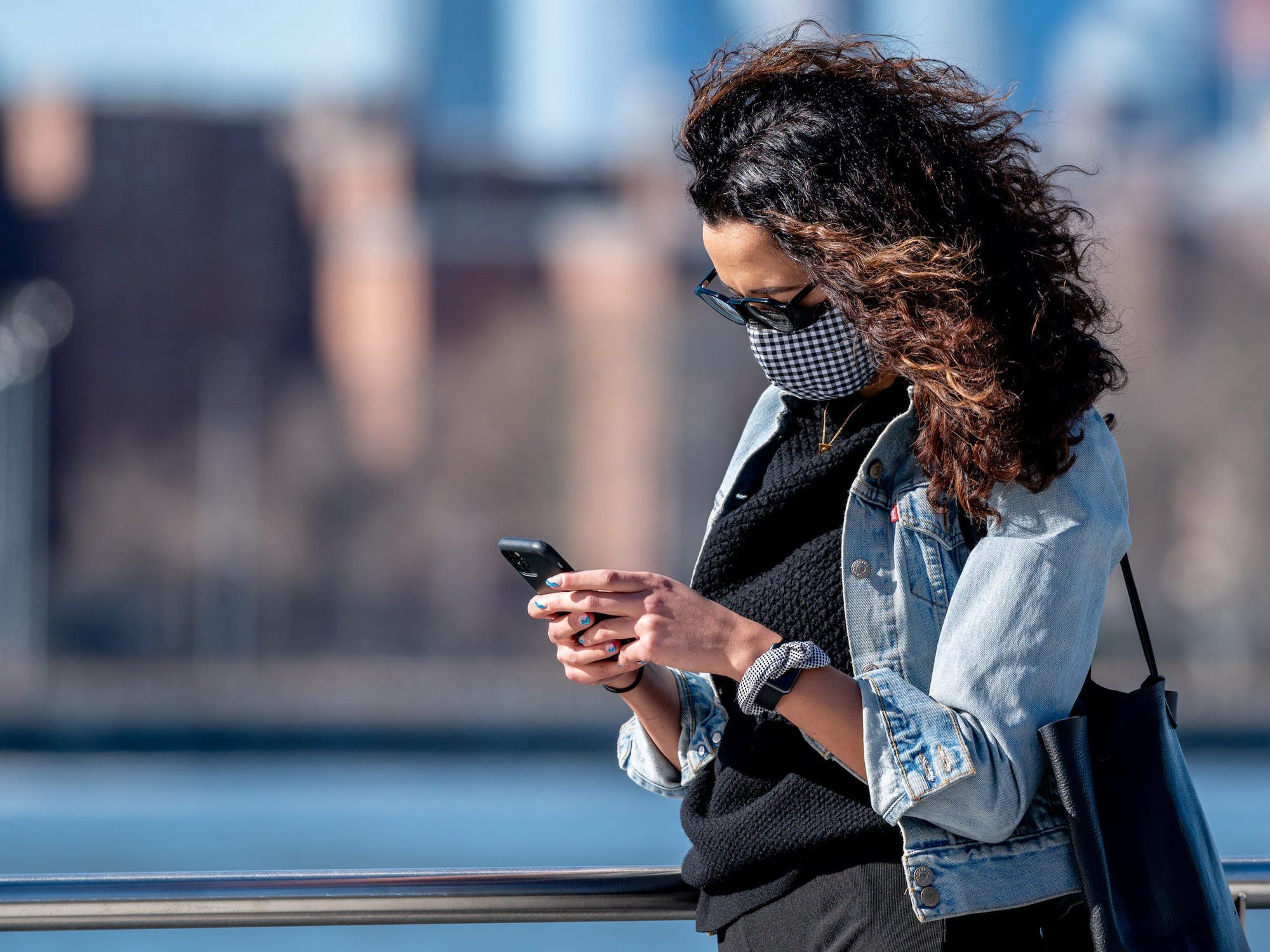 An individual using a cellphone.