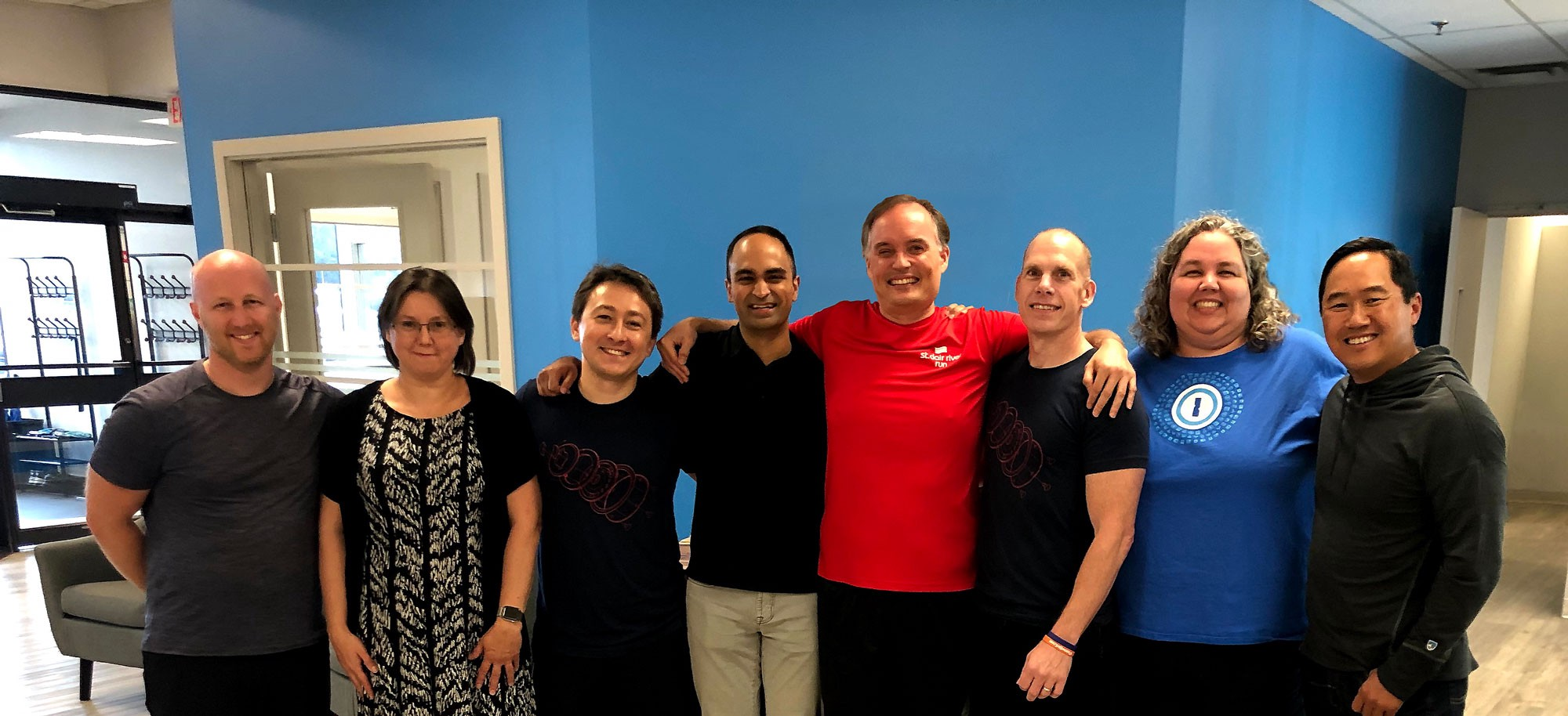 Group hug after sealing the deal in our St. Thomas, Ontario office. From left to right: Dan Levine, Natalia Karimova, Roustem