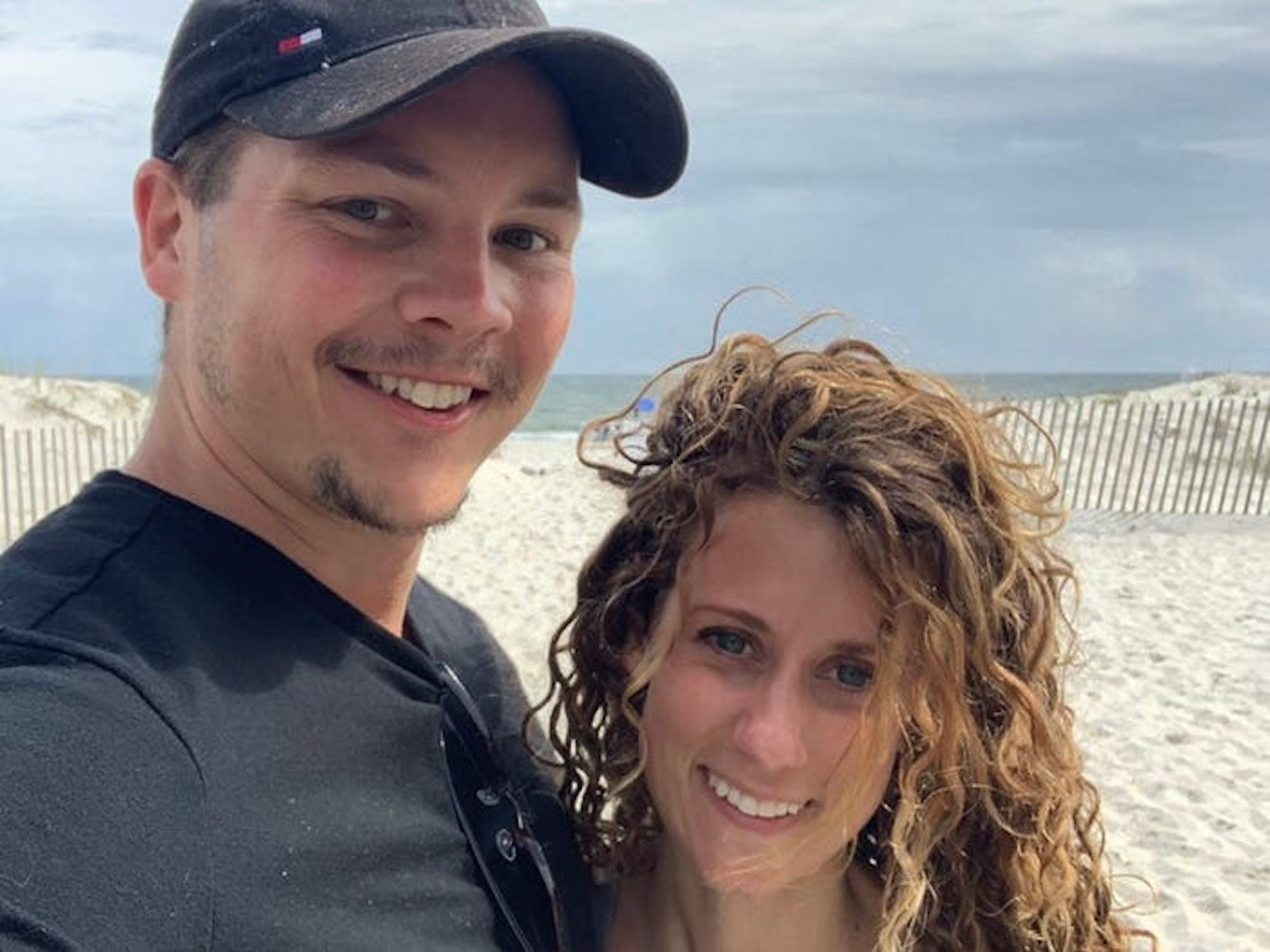 Olivia Christensen (right) with her husband at the beach.