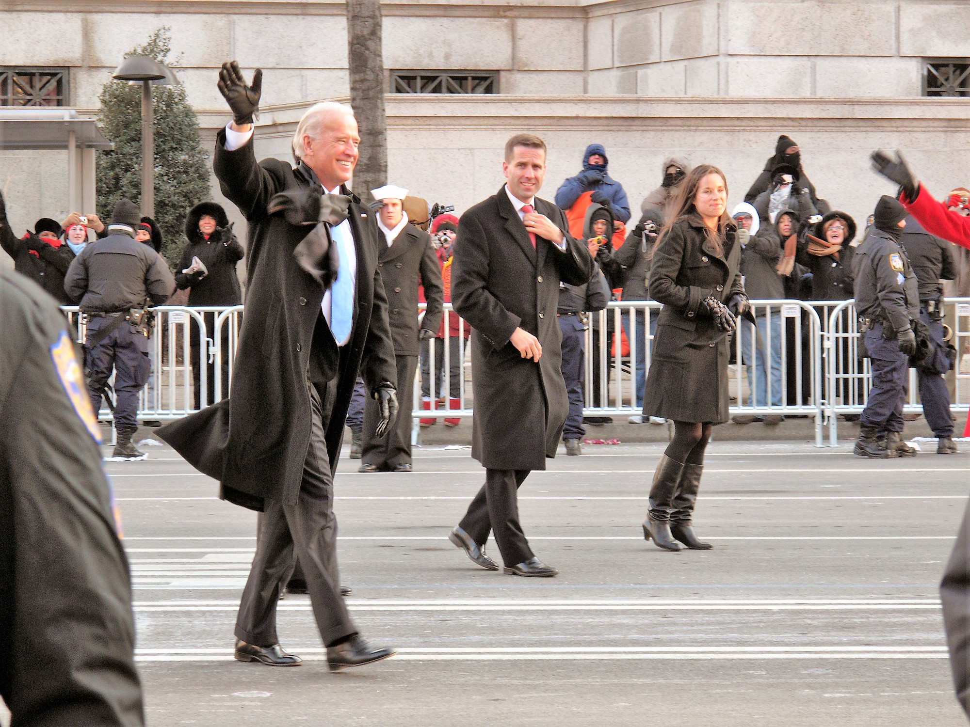 Biden walks in a parade with his youngest son and daughter