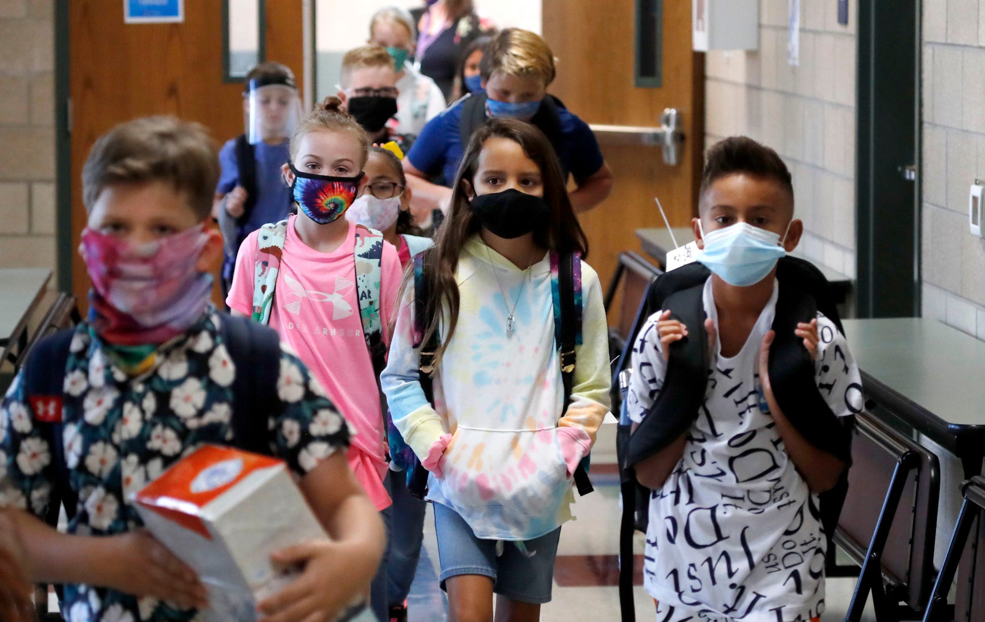 Elementary-school students walk to classes in Godley, Texas, on August 5.