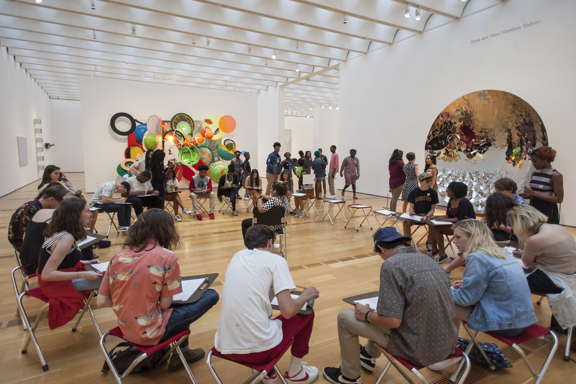 Teens draw a live model in the High Museum's galleries.