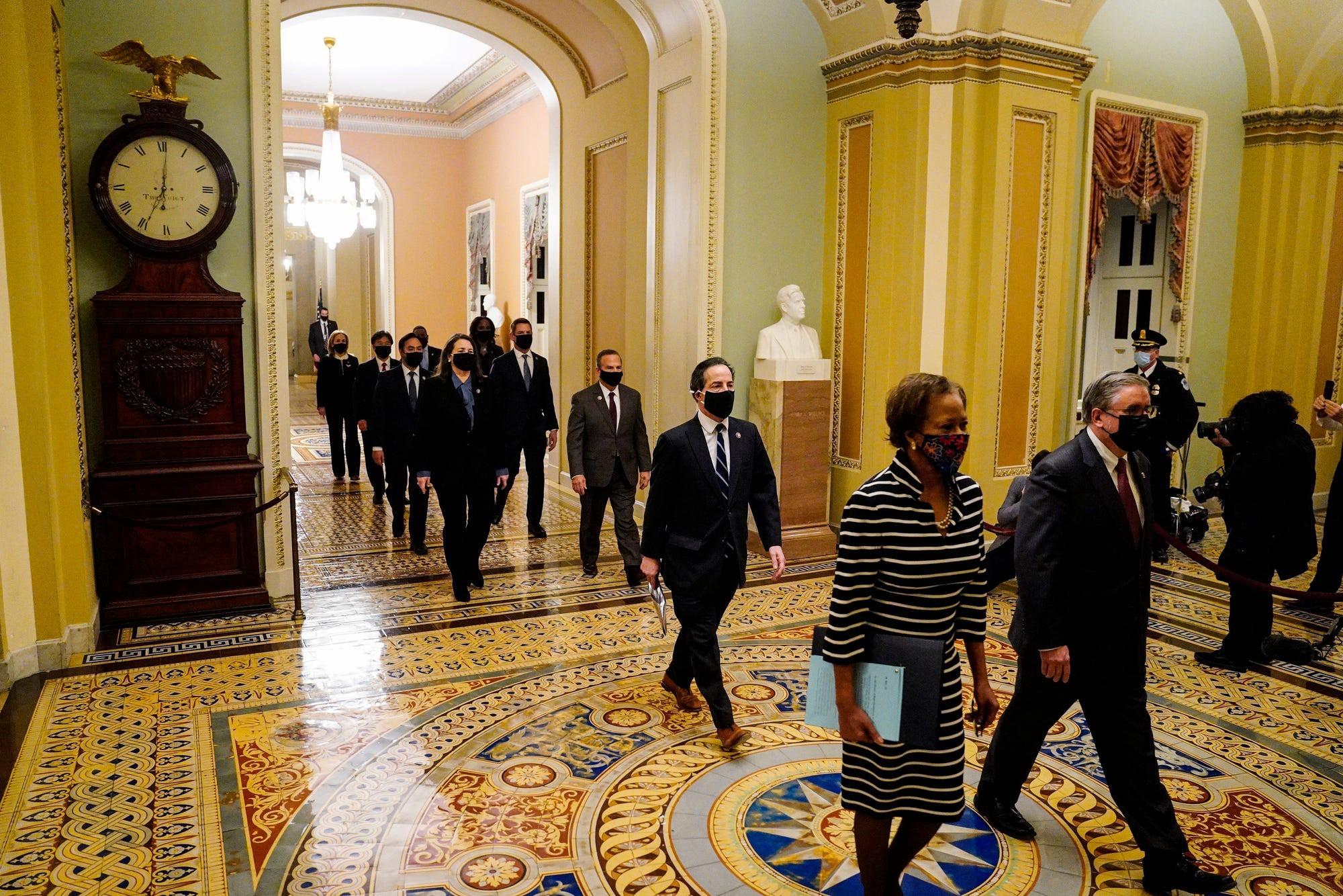 Democratic House impeachment managers walk through the Capitol to deliver the article of impeachment.