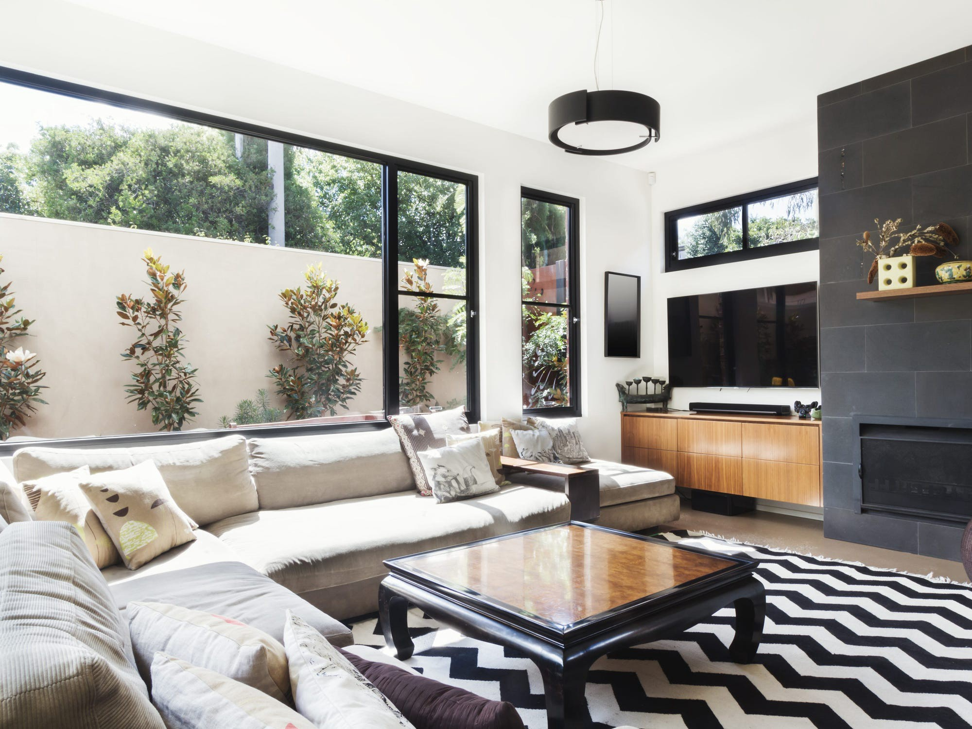 A modern living room with a black and white color scheme.
