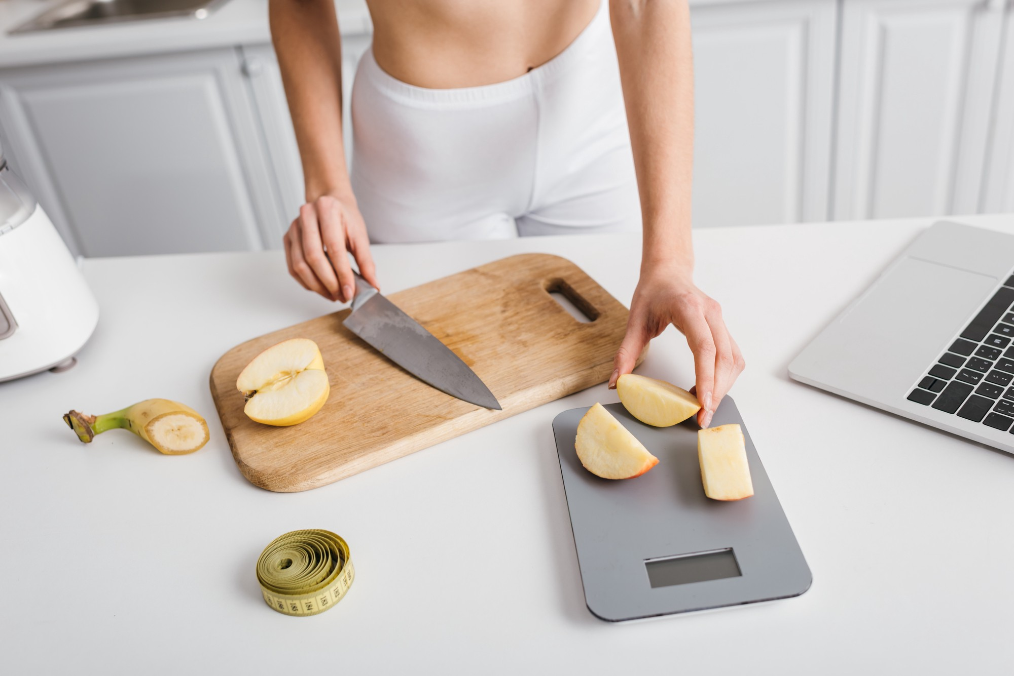 a woman weighing her food on a food scale