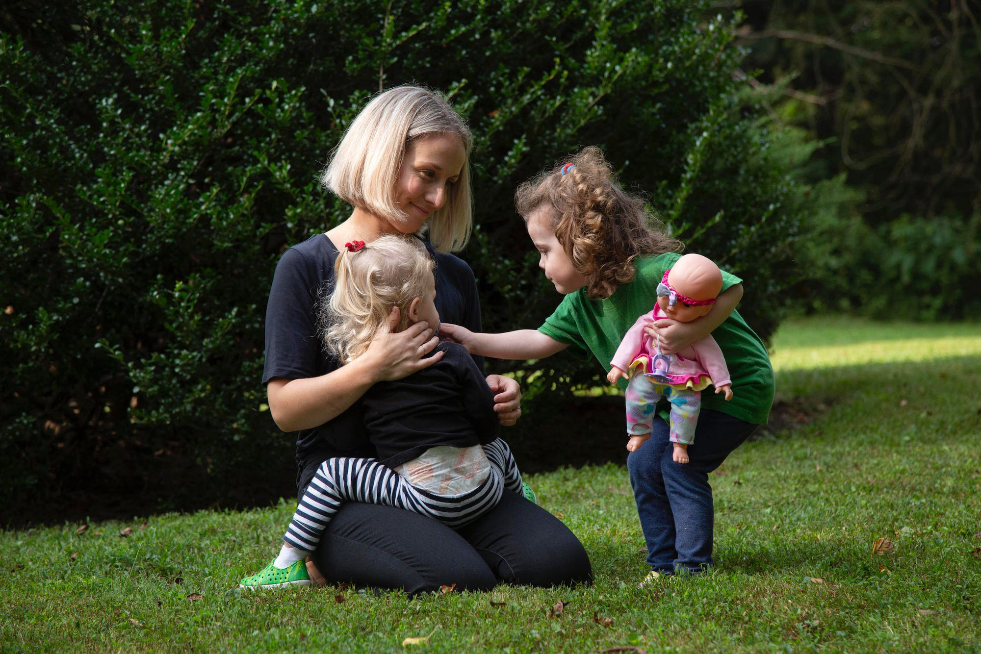 Ariane Audet playing with her two kids outside.