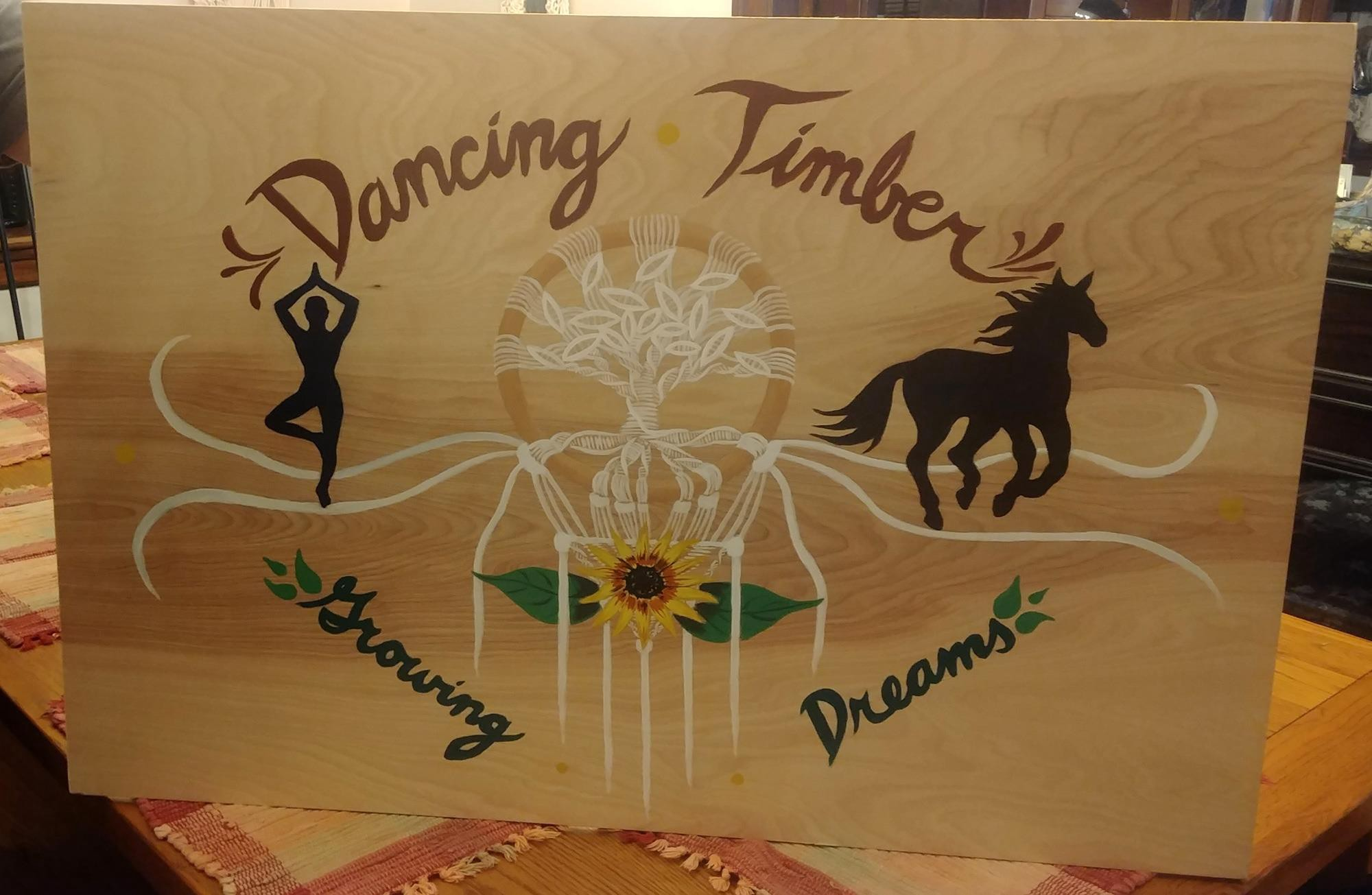 "The sign that was made for Dancing Timber with the words ""Growing Dreams"" on it was commissioned for us by my sister."