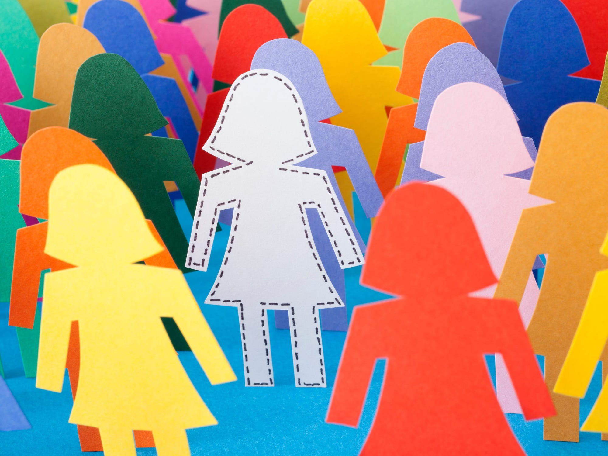 A graphic featuring colorful silhouette cutouts shaped like women.