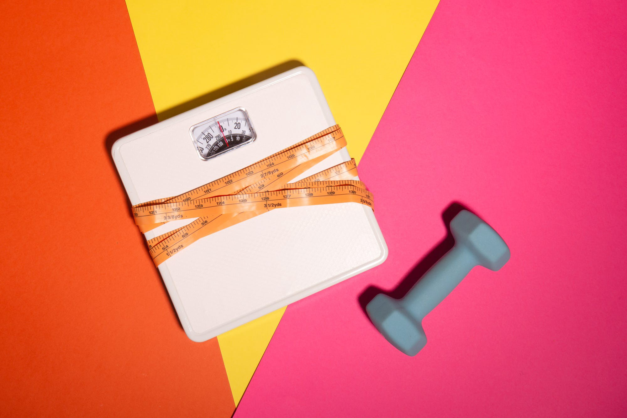 A scale and a dumbbell.
