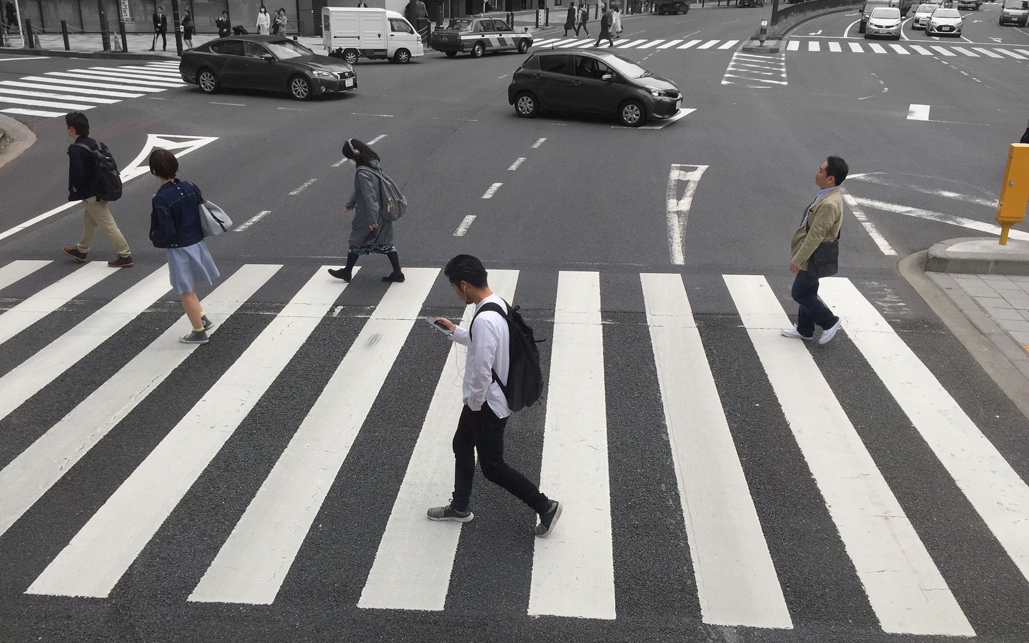 The zebra crossing outside Tokyo Midtown West Station photographed by Paul Boakye (2018)