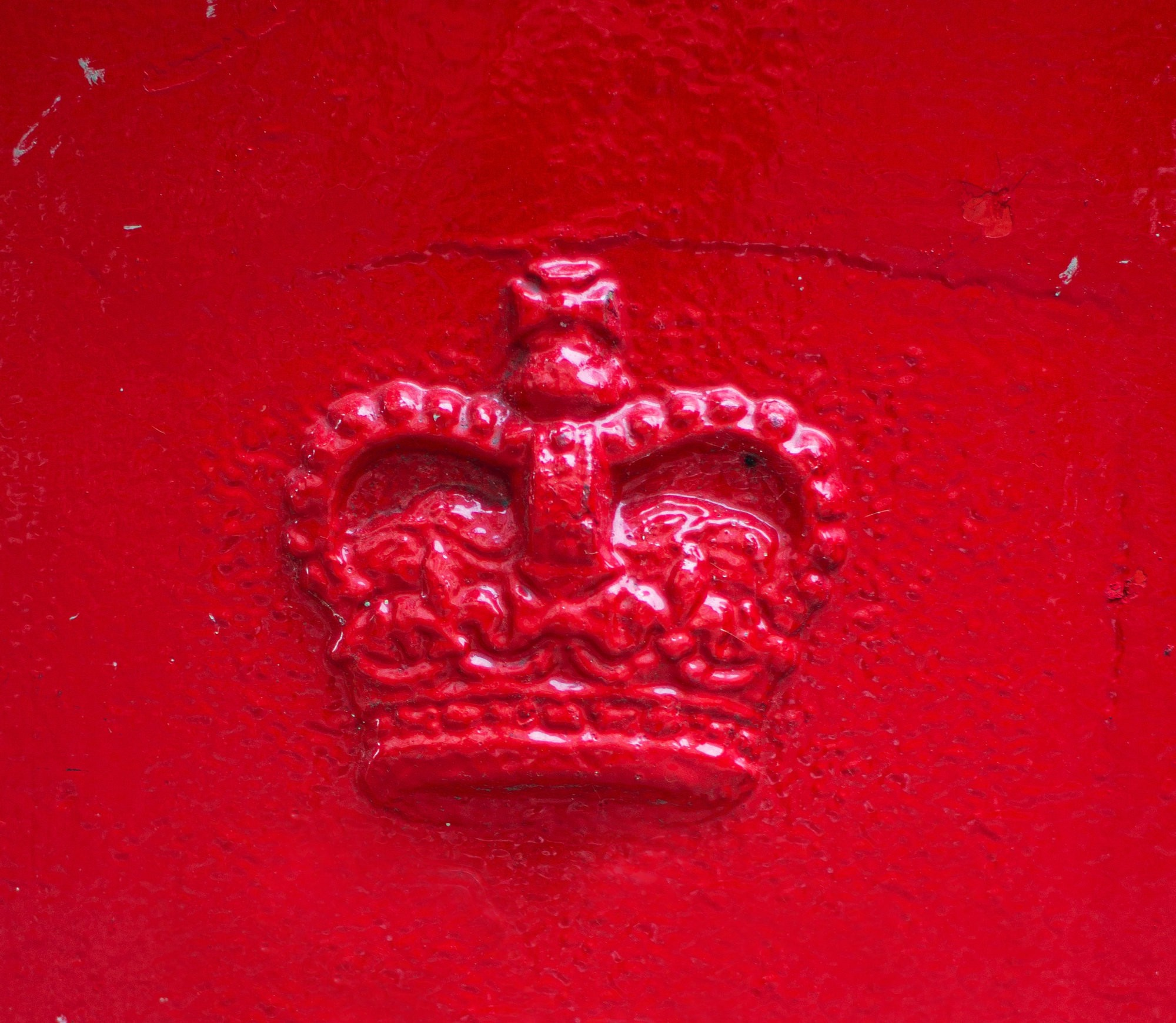 HRM crown symbol cast in iron and painted red.