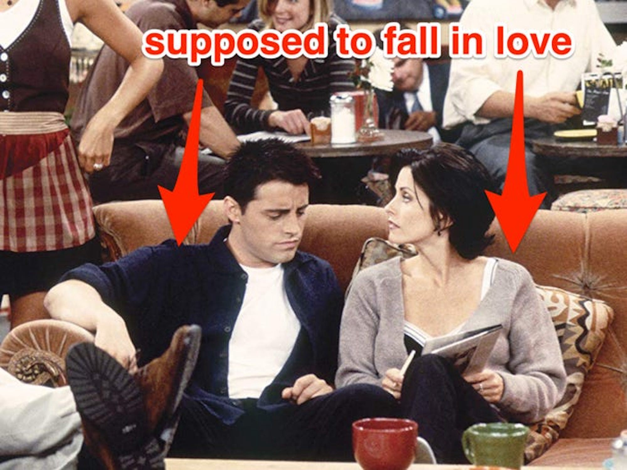"""A scene from """"Friends"""" featuring Joey and Monica with the words """"Supposed to fall in Love"""" in red above them."""