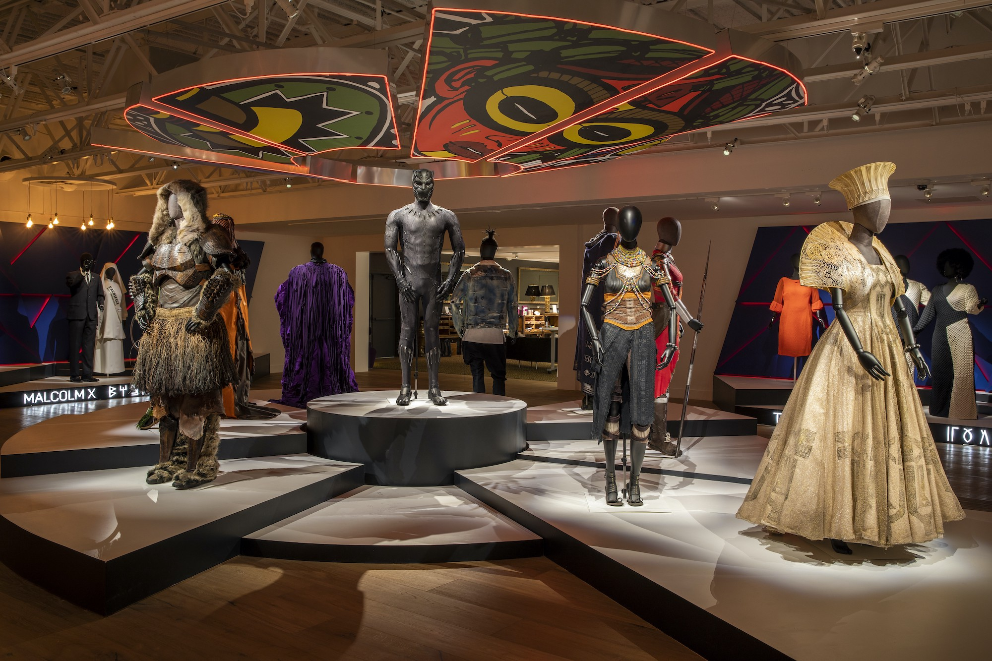 """Costumes on display at the """"Ruth E. Carter: Afrofuturism in Costume Design"""" exhibition at the SCAD FASH Museum of Fashion + Film in Atlanta, GA."""