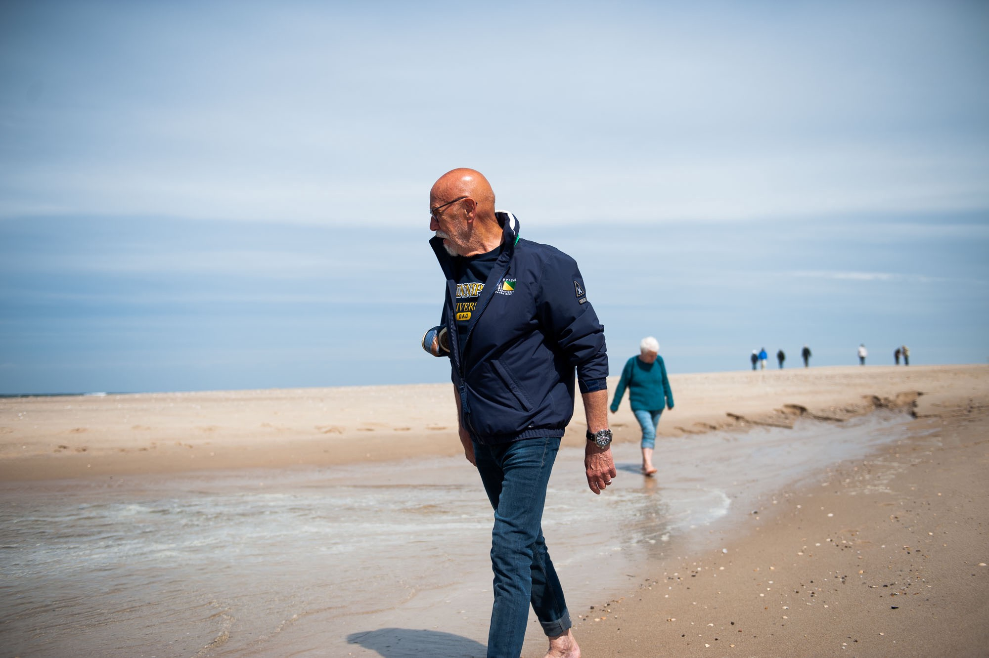 Dad leads mom on their beach walk near Baakdeel. Rantum, Germany, May 24, 2019.
