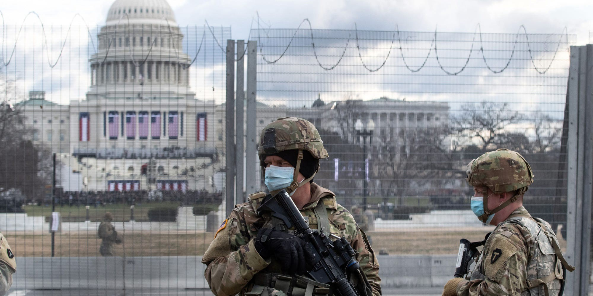 US National Guard troops patrol the vicinity of the US Capitol hours before the Inauguration of US President-Elect Joe Biden.
