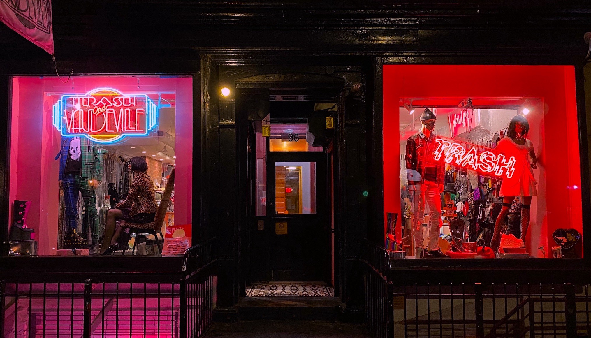 Neon lights and mannequins in the store window of Trash and Vaudeville, located in New York's East Village.
