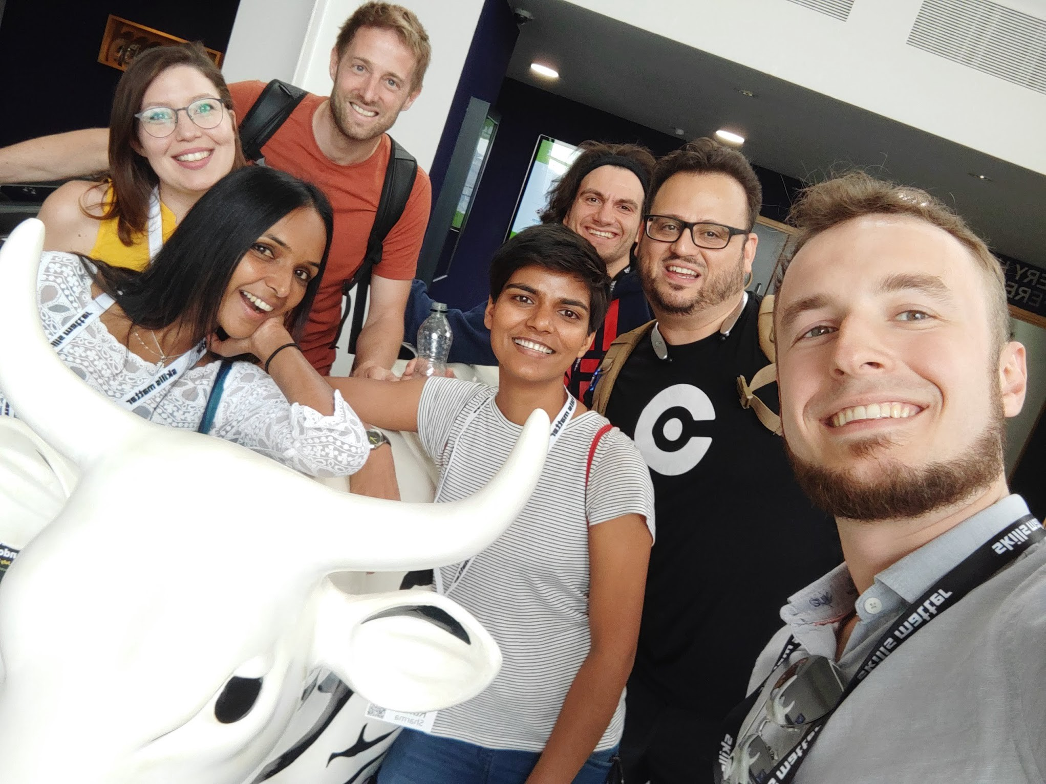 A group selfie with a cow