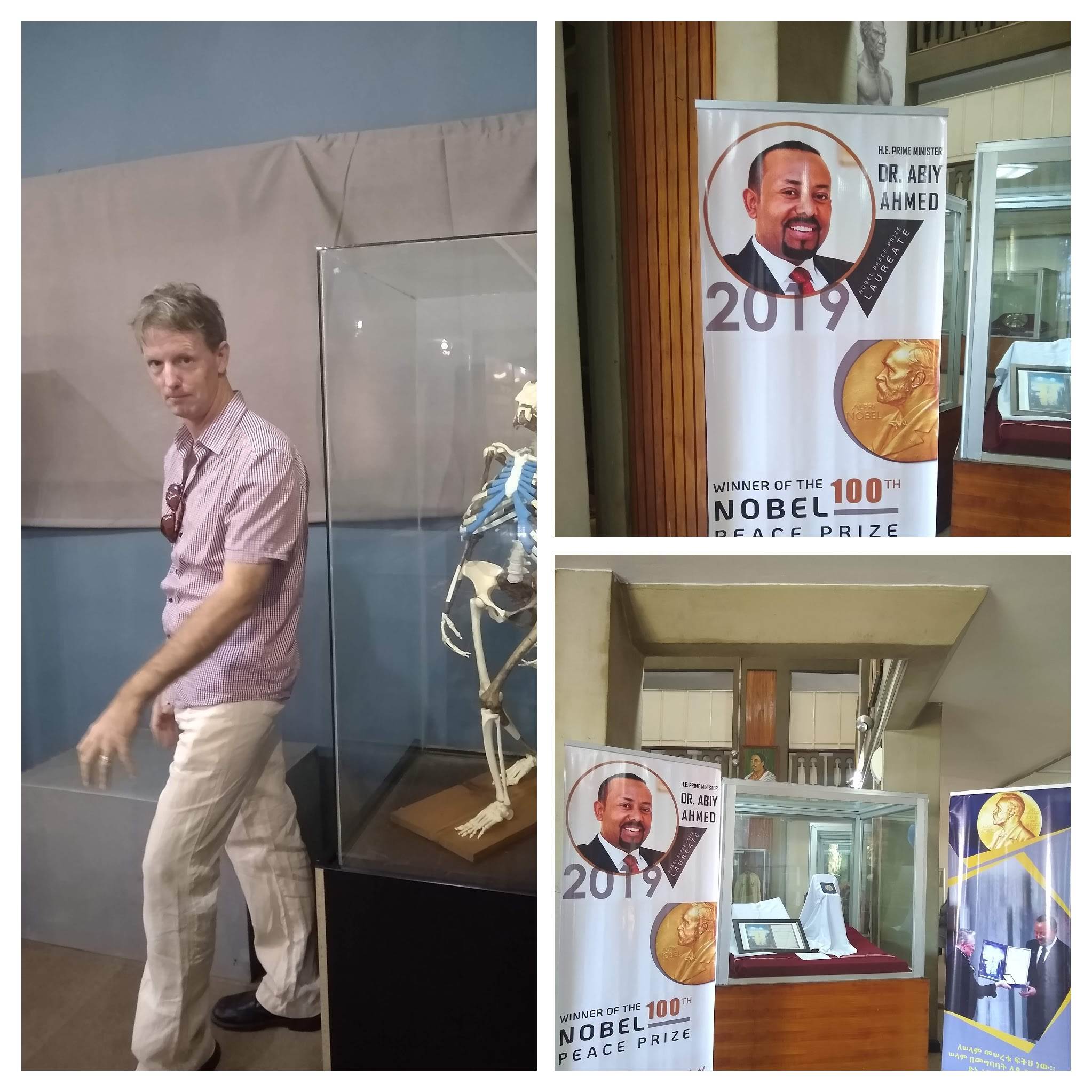 My husband poses by Lucy. Photos of the display of Abiy's Nobel.