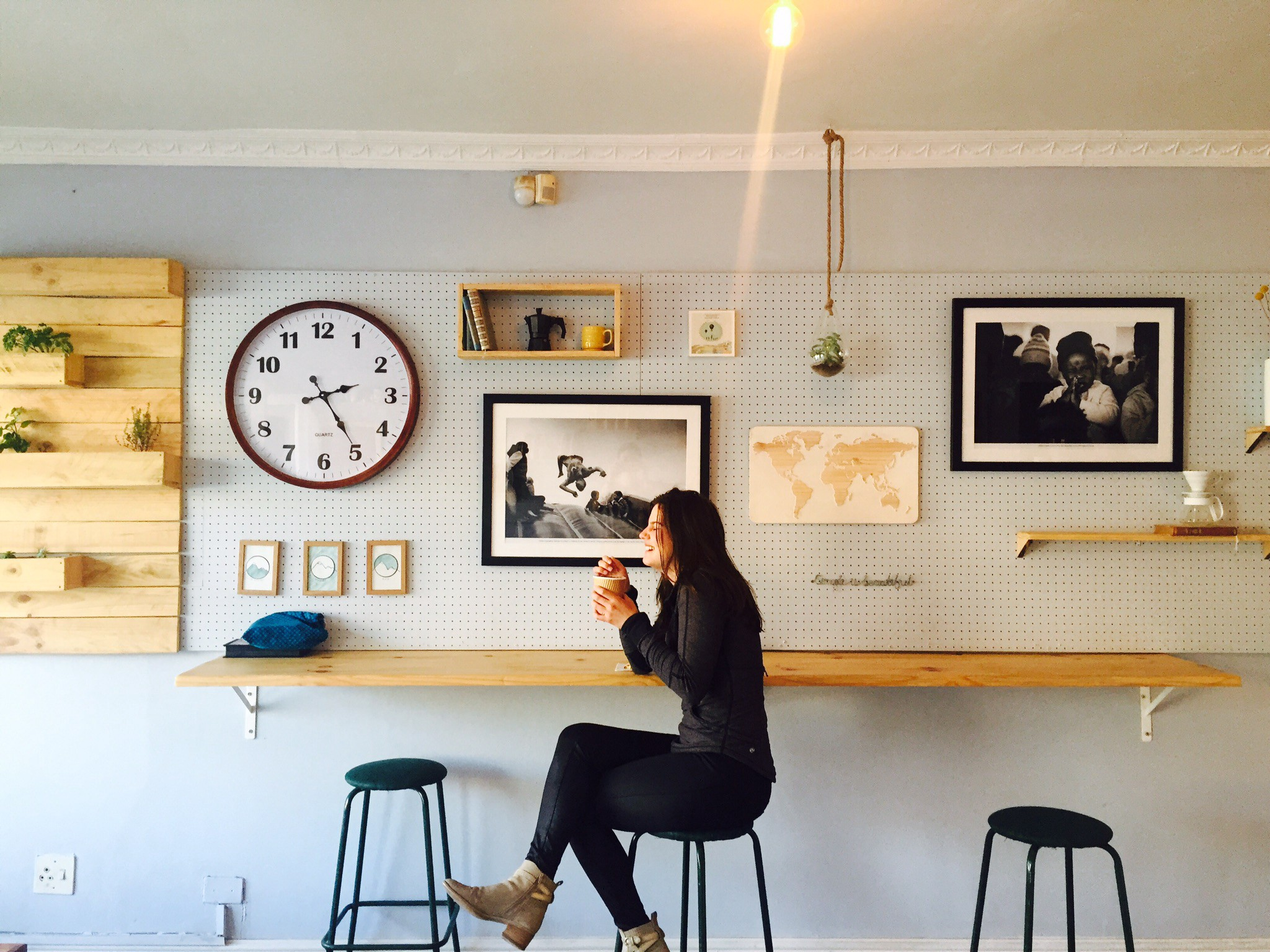 Woman sitting alone in coffee shop, smiling