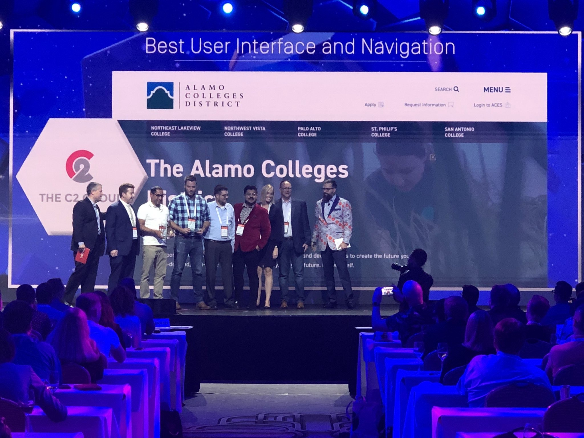 "The C2 Group and Alamo Colleges on stage to accept the ""Best User Interface and Navigation"" award for Alamo's website."