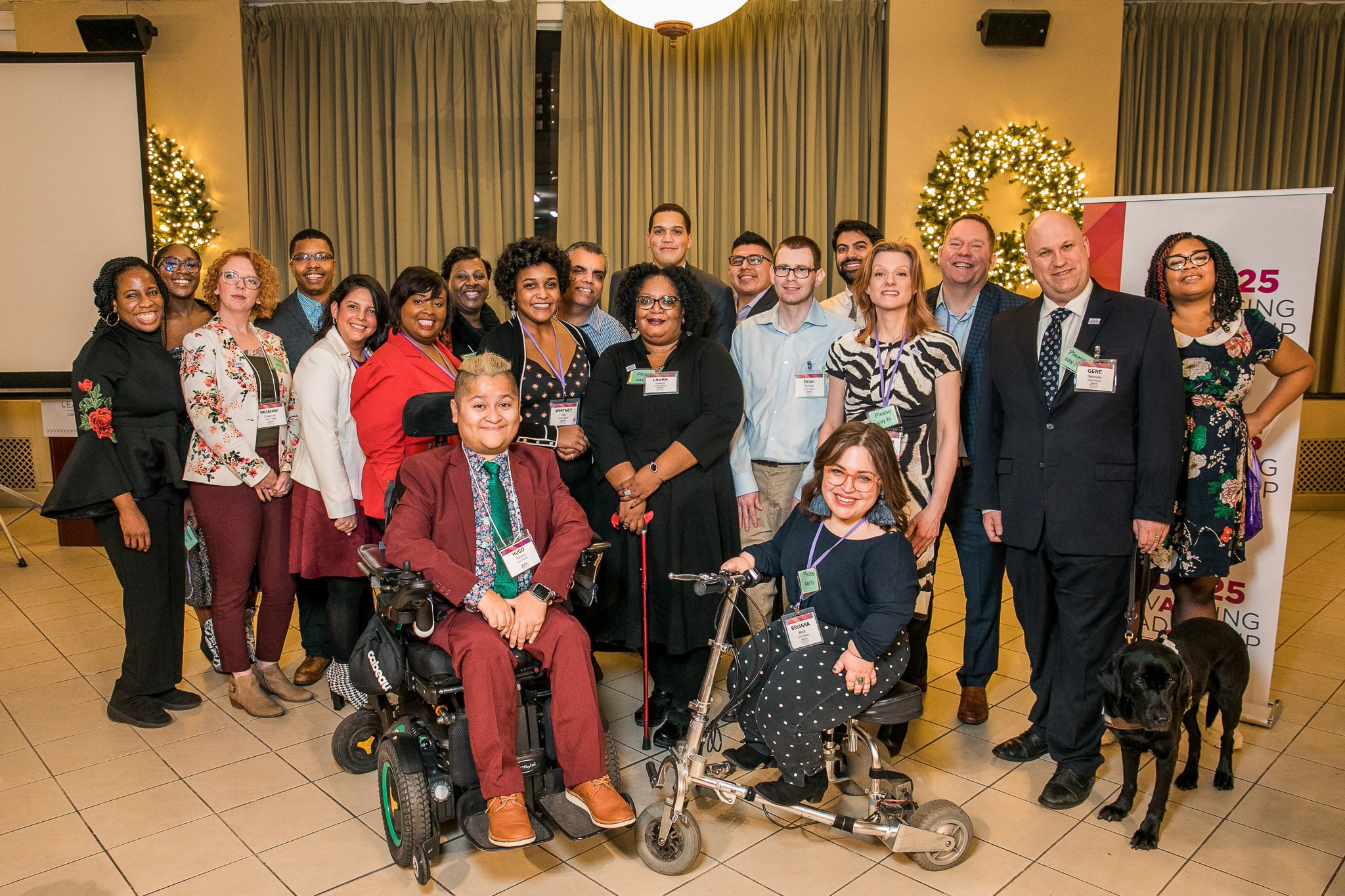 A group photo of about 20 people with visible and invisible disabilities pose with State Senator Robert Peters.