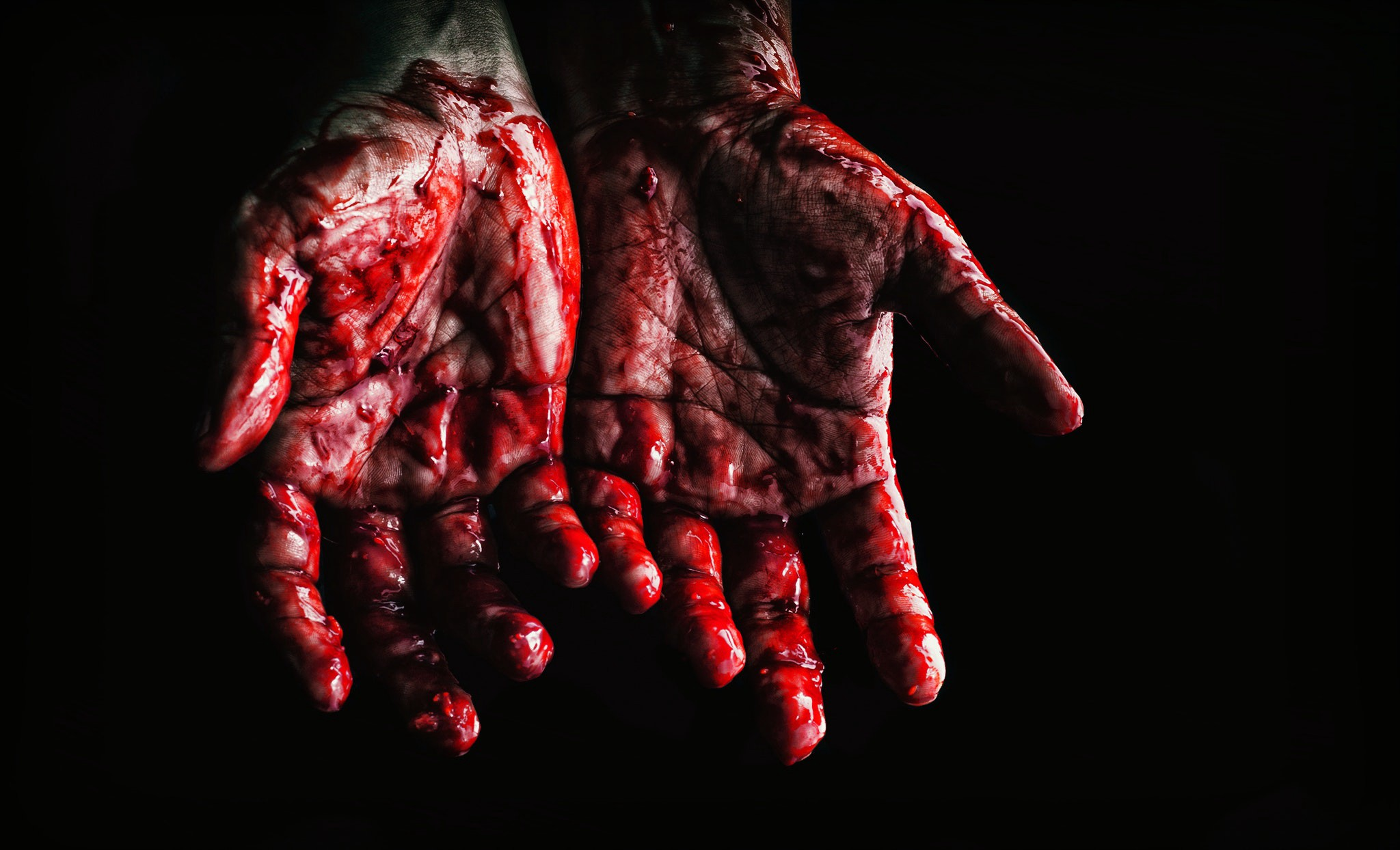 Person's Hands Covered With Blood