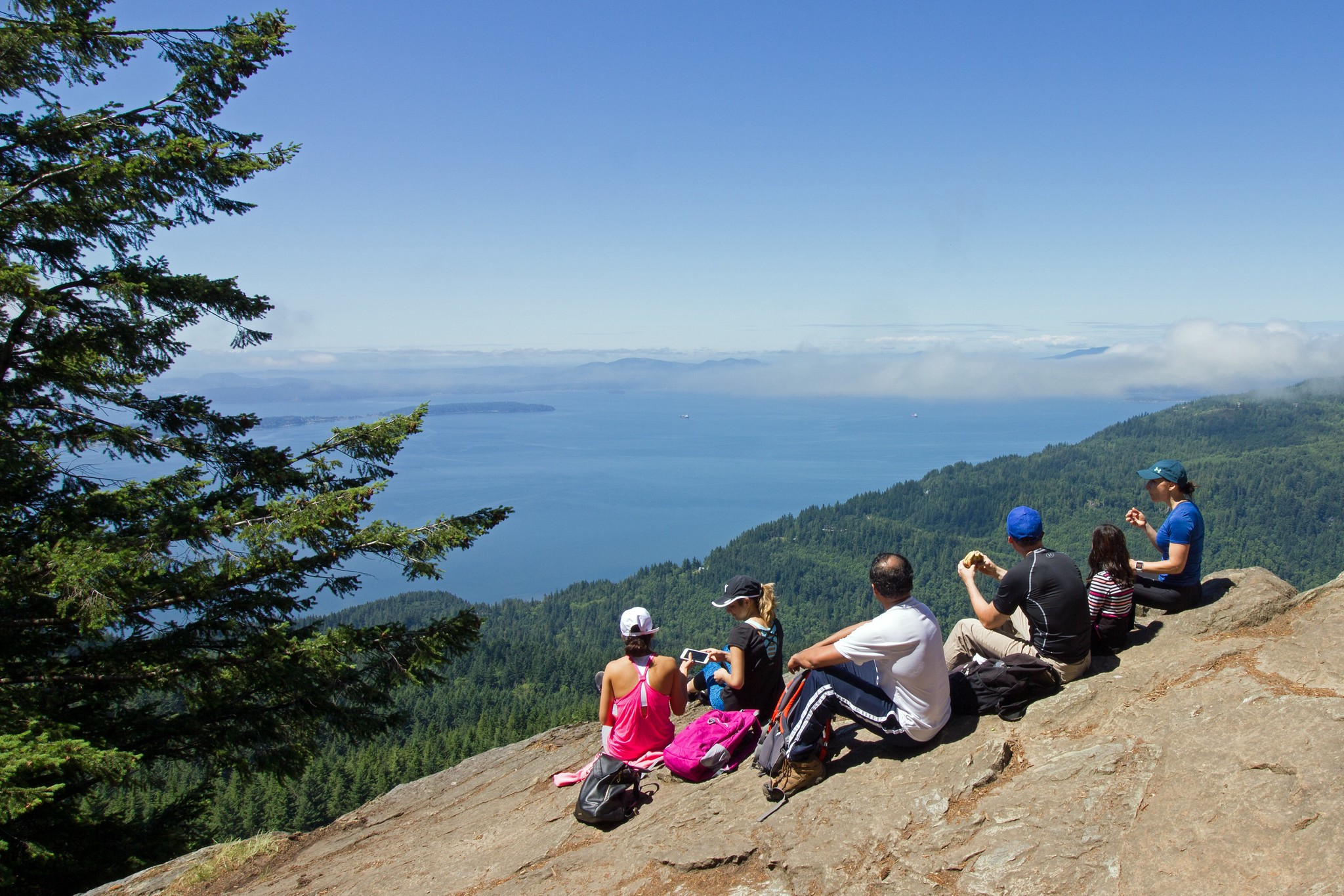 Photo of a group of people enjoying the view from Oyster Dome, near Bellingham, Washington. Photo: Kirk and Barb Nelson