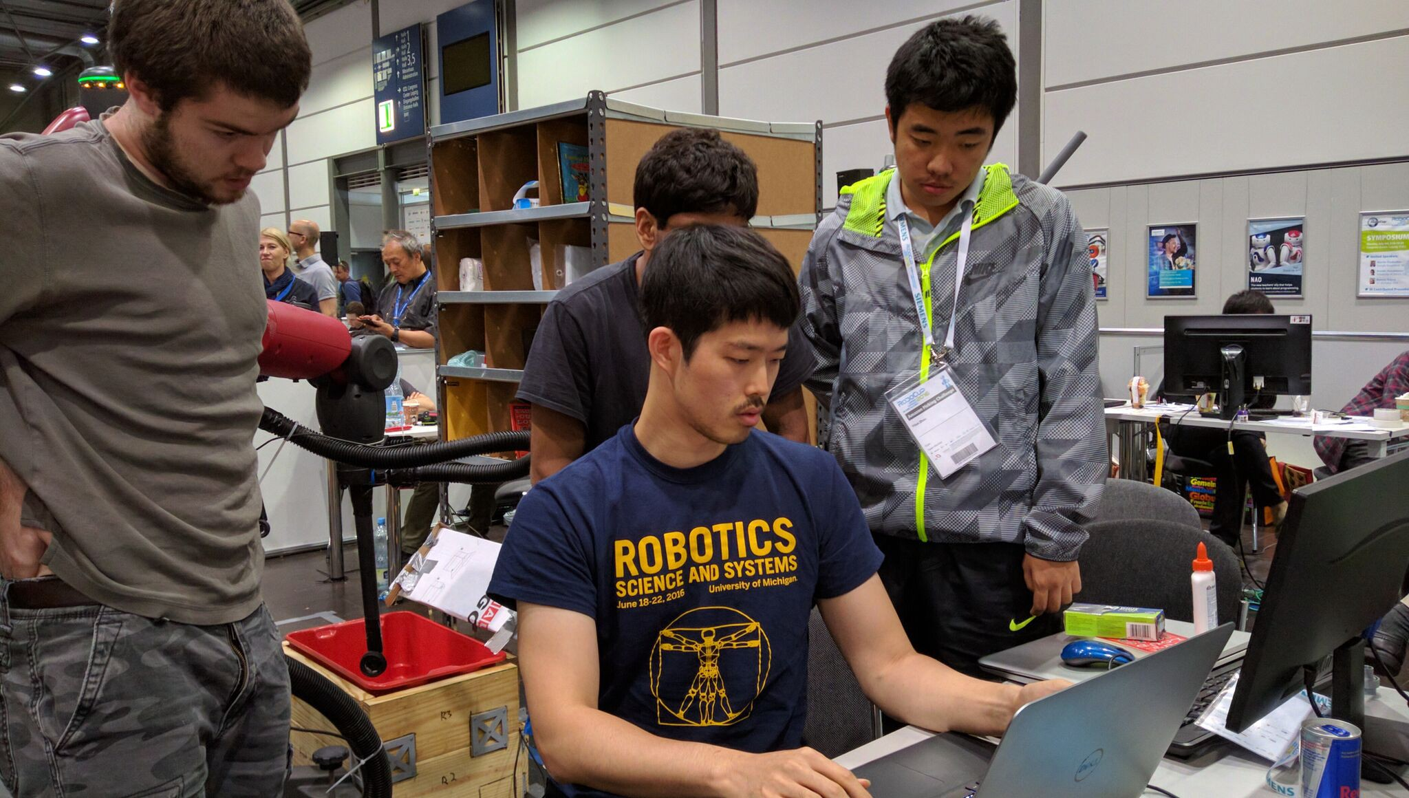 Students programming a robot during the Amazon Picking Challenge, 2016
