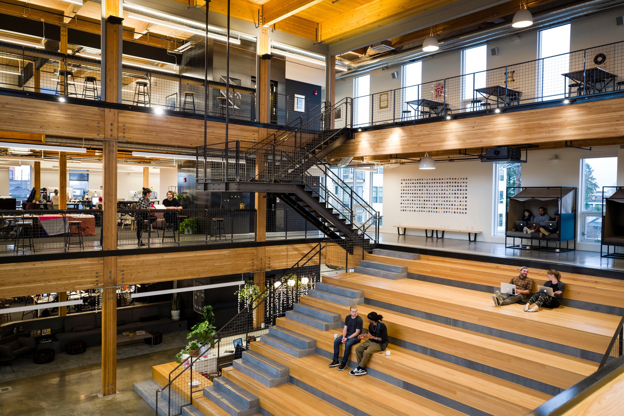 Interiors of Instrument's Portland office featuring a lobby and staircase leading to floors 2 and 3