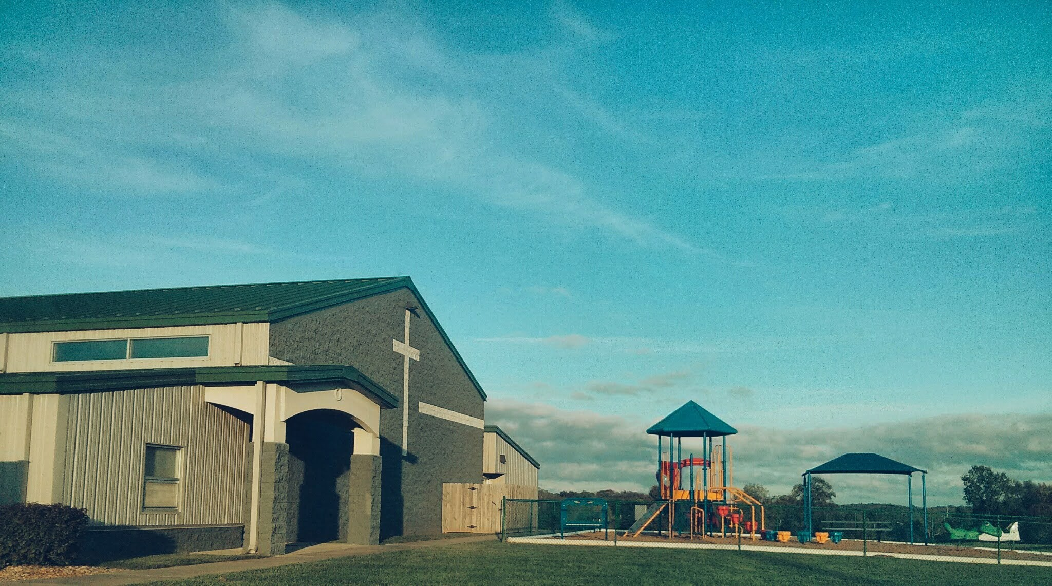 a church building with a playground