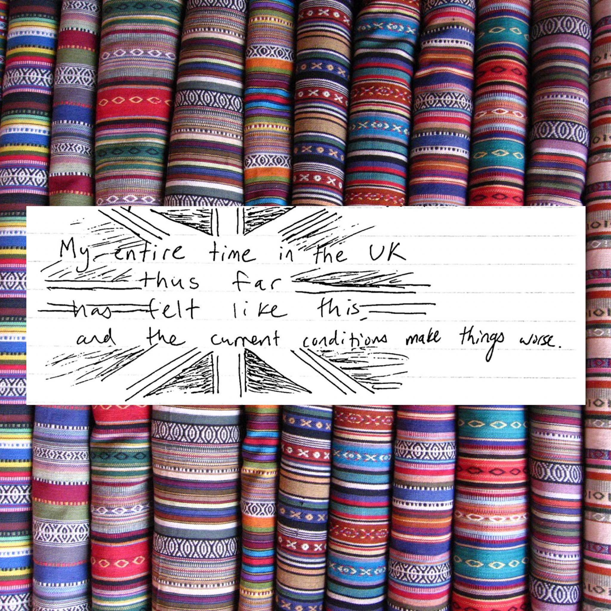 A background photo of colorful cloths has a white square and handwritten text, read in the photo caption.