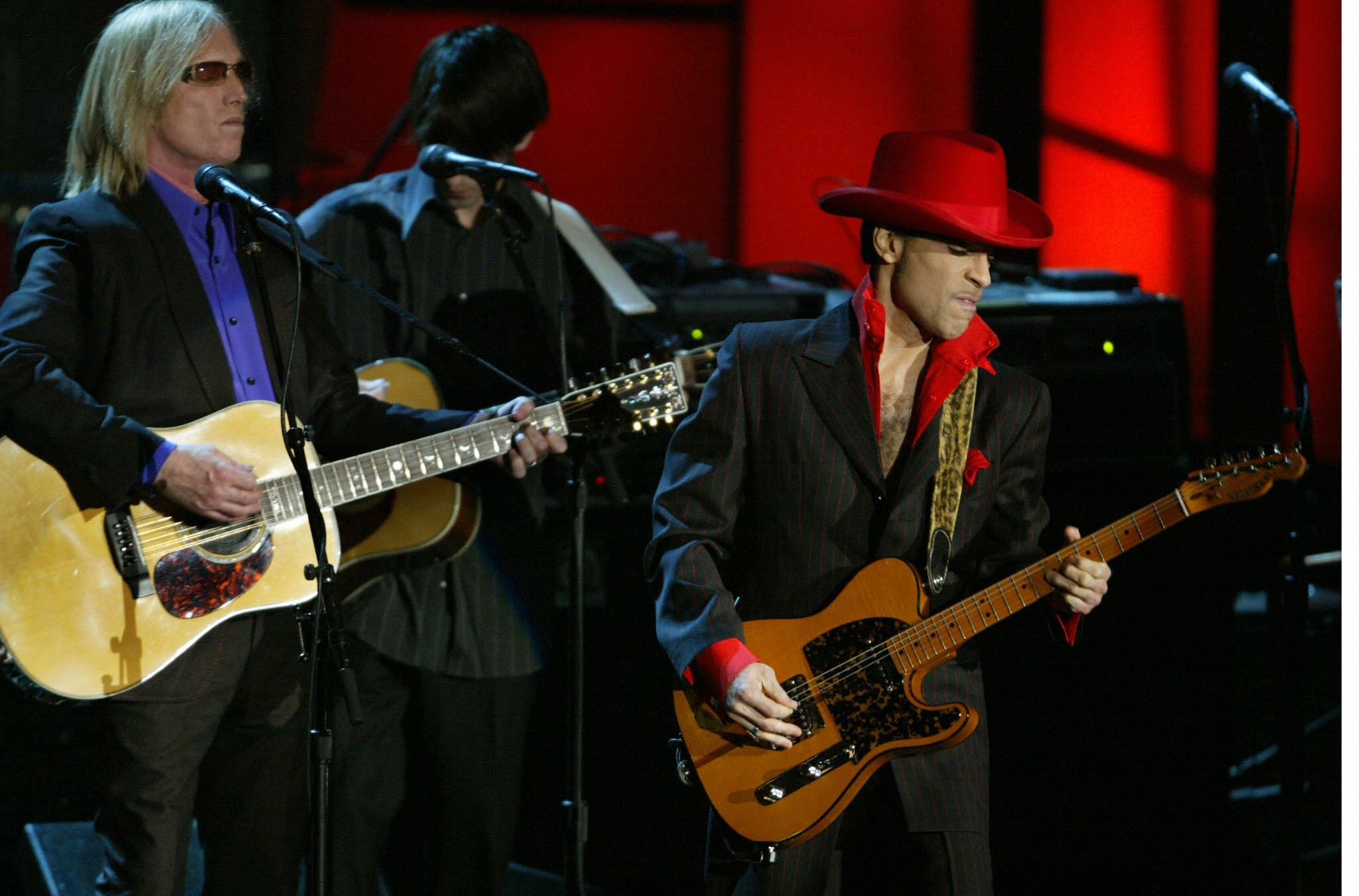 Prince performs along with Tom Petty at the 19th Annual Rock and Roll Hall of Fame Induction Ceremony in New York City, 2004.