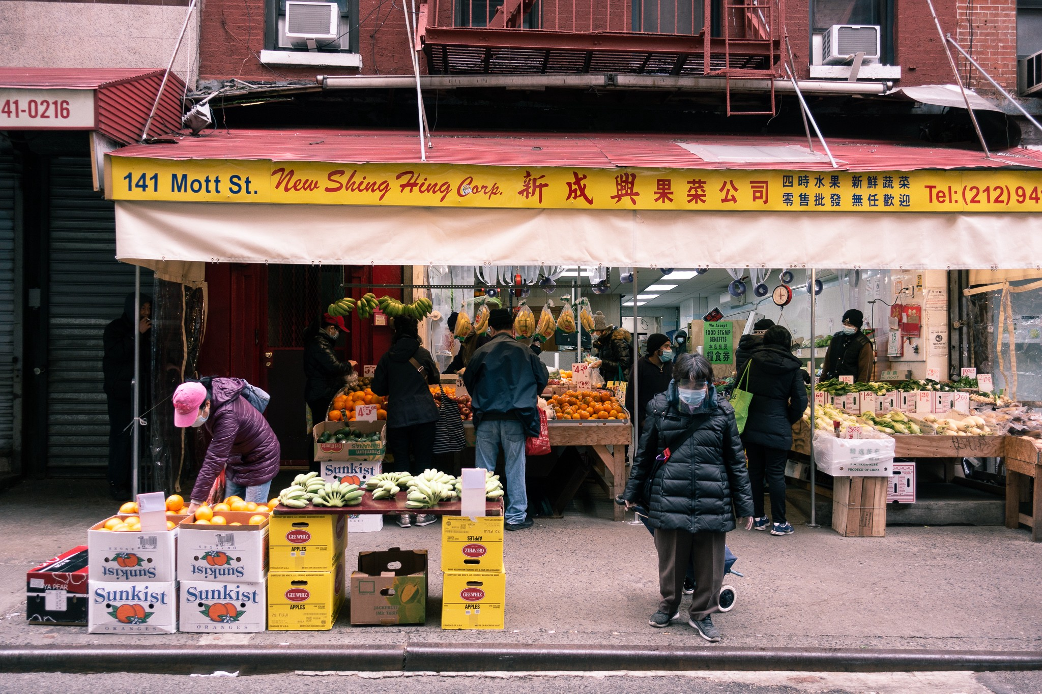 Chinatown, NYC, New York Chinatown, in Manhattan, Chinese storefront with vegetables, fruits, Chinese lettering
