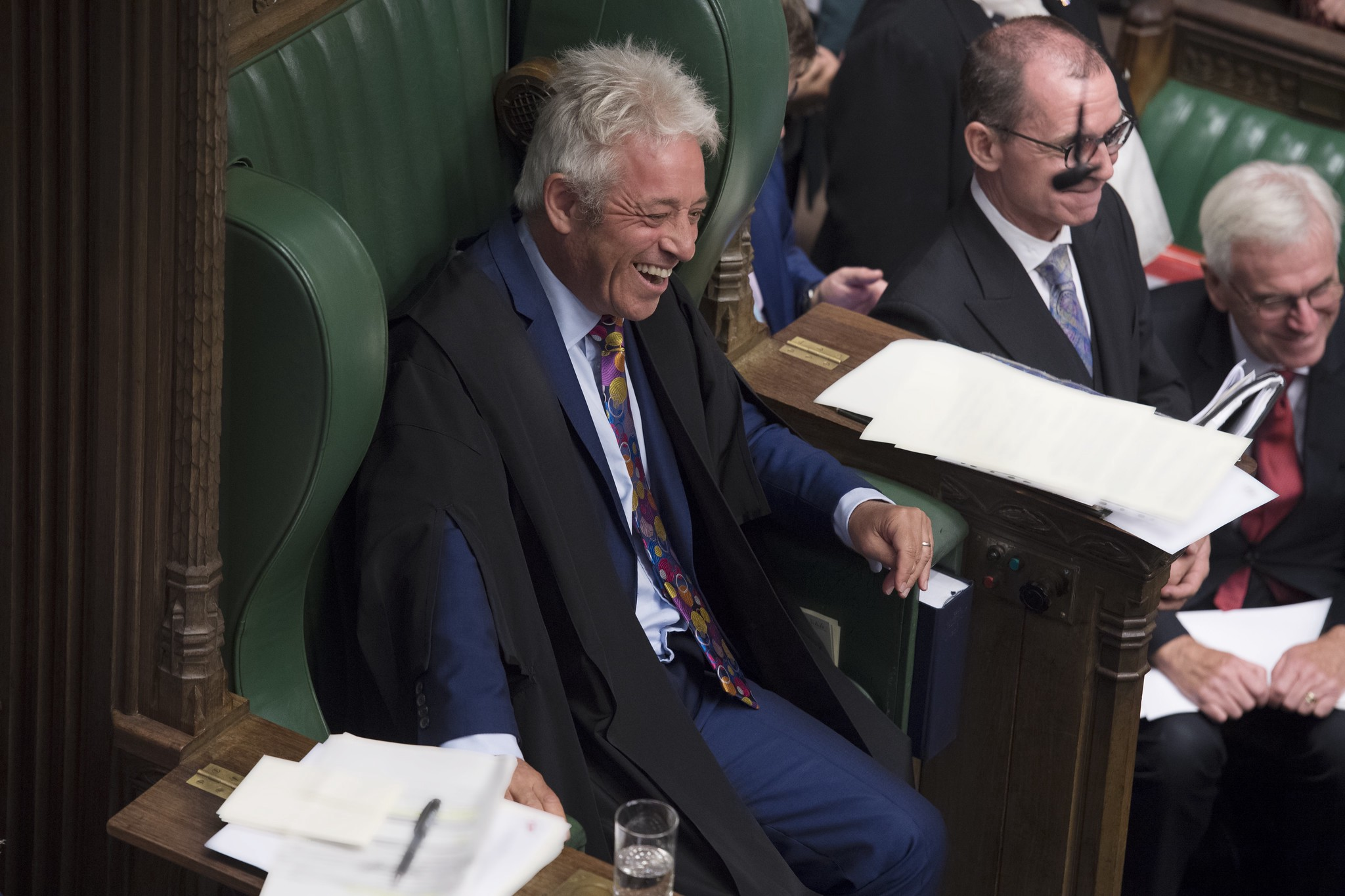 Pic of John Bercow smiling in the green House of Commons speakers seat